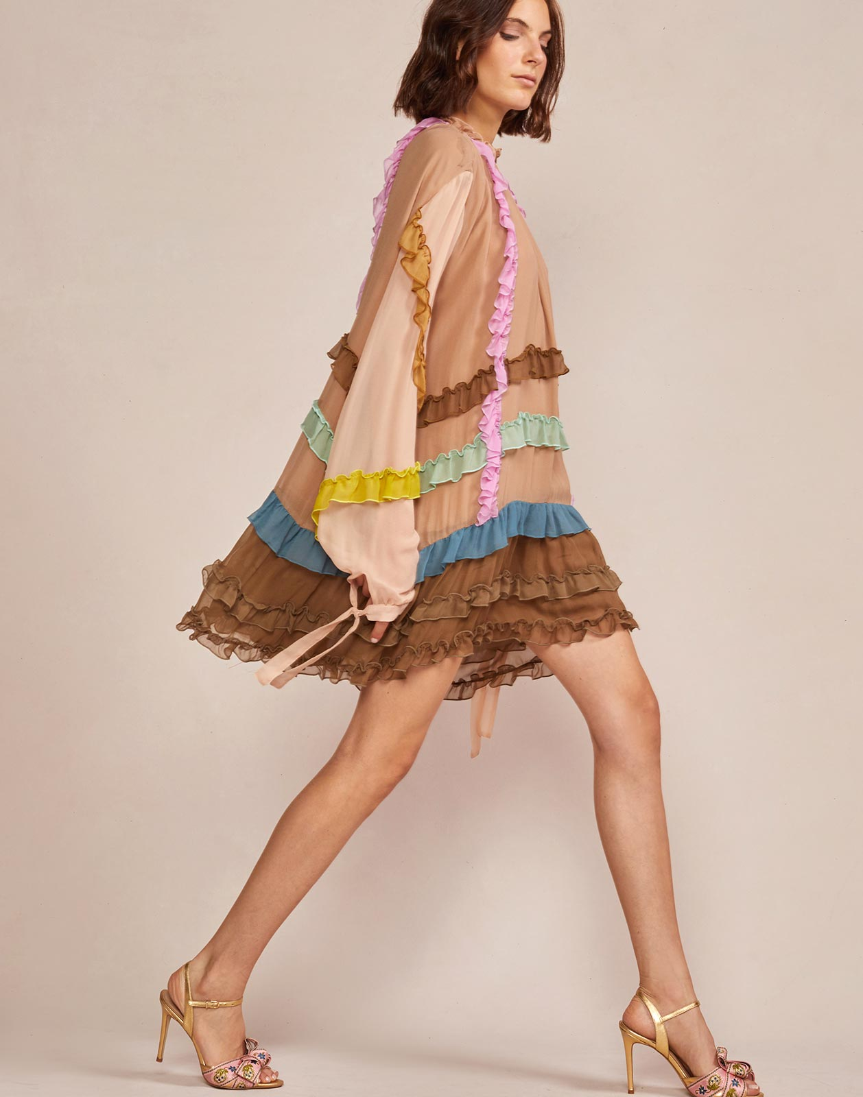 Side view of sand combo mini dress with sheer sleeve detail
