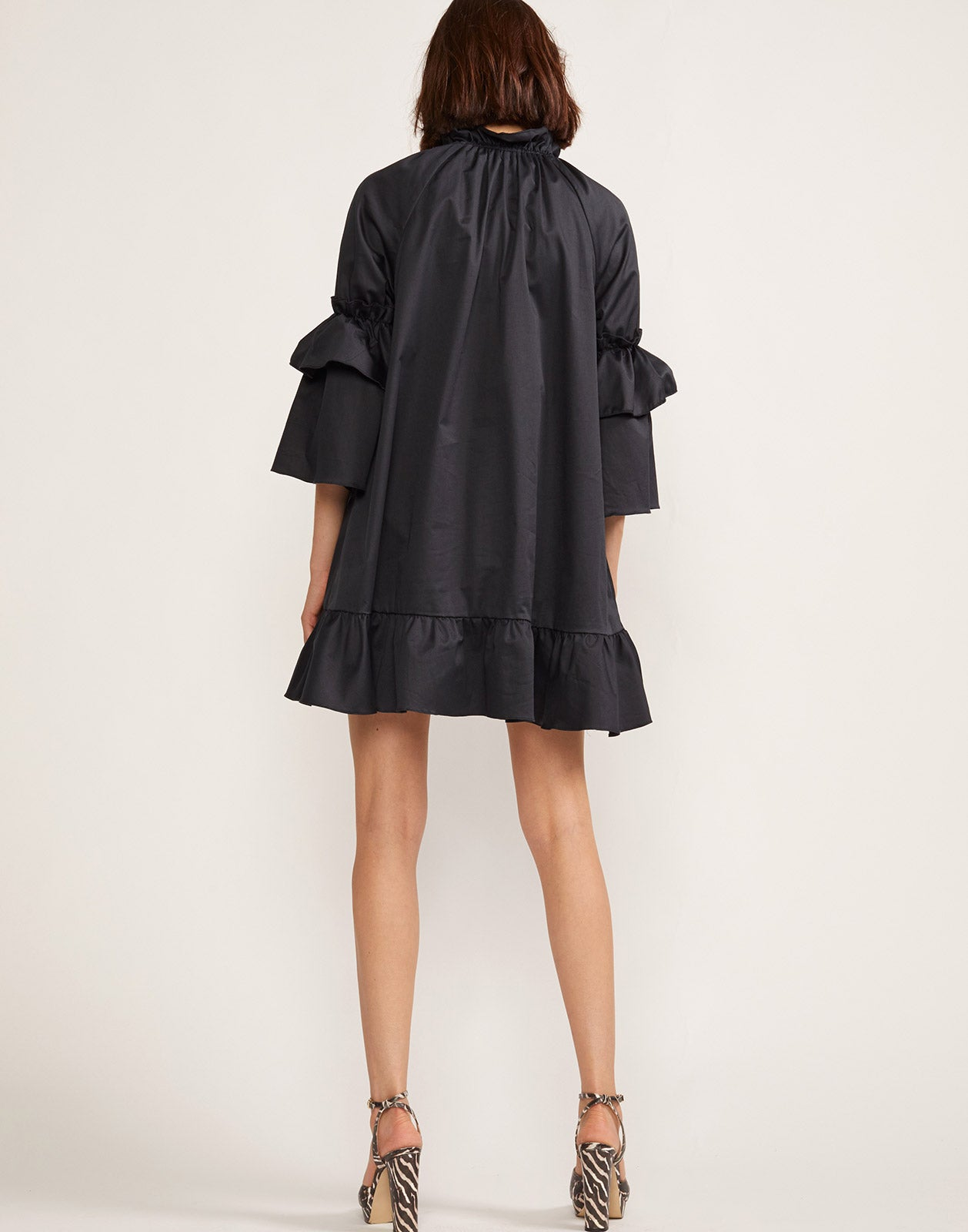 Alternate full back view model wearing Eden Ruffle Sleeve Mini Dress