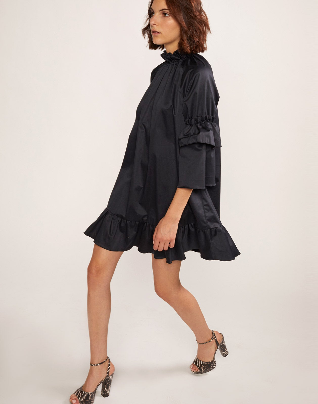 Alternate full side view model wearing Eden Ruffle Sleeve Mini Dress