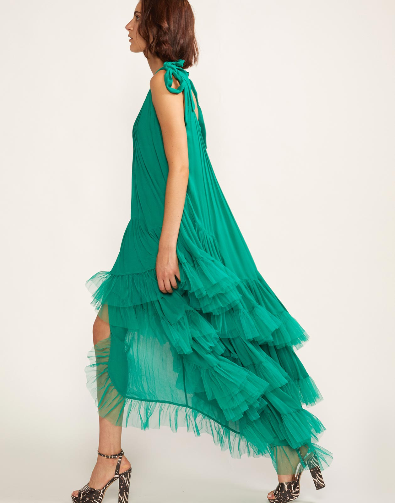 Side view of flounce dress with sheer tulle tiered ruffle bottom