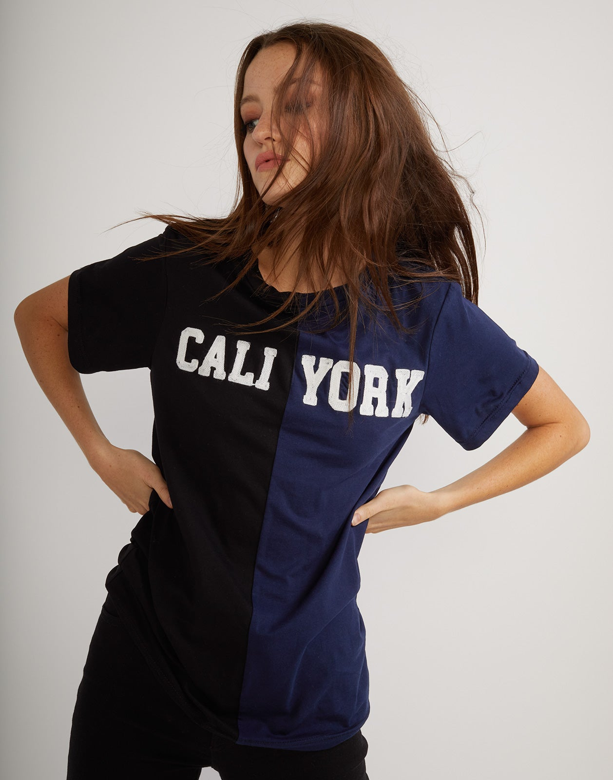 Front detail view of the short sleeved half black, half navy caliyork tee in soft cotton.