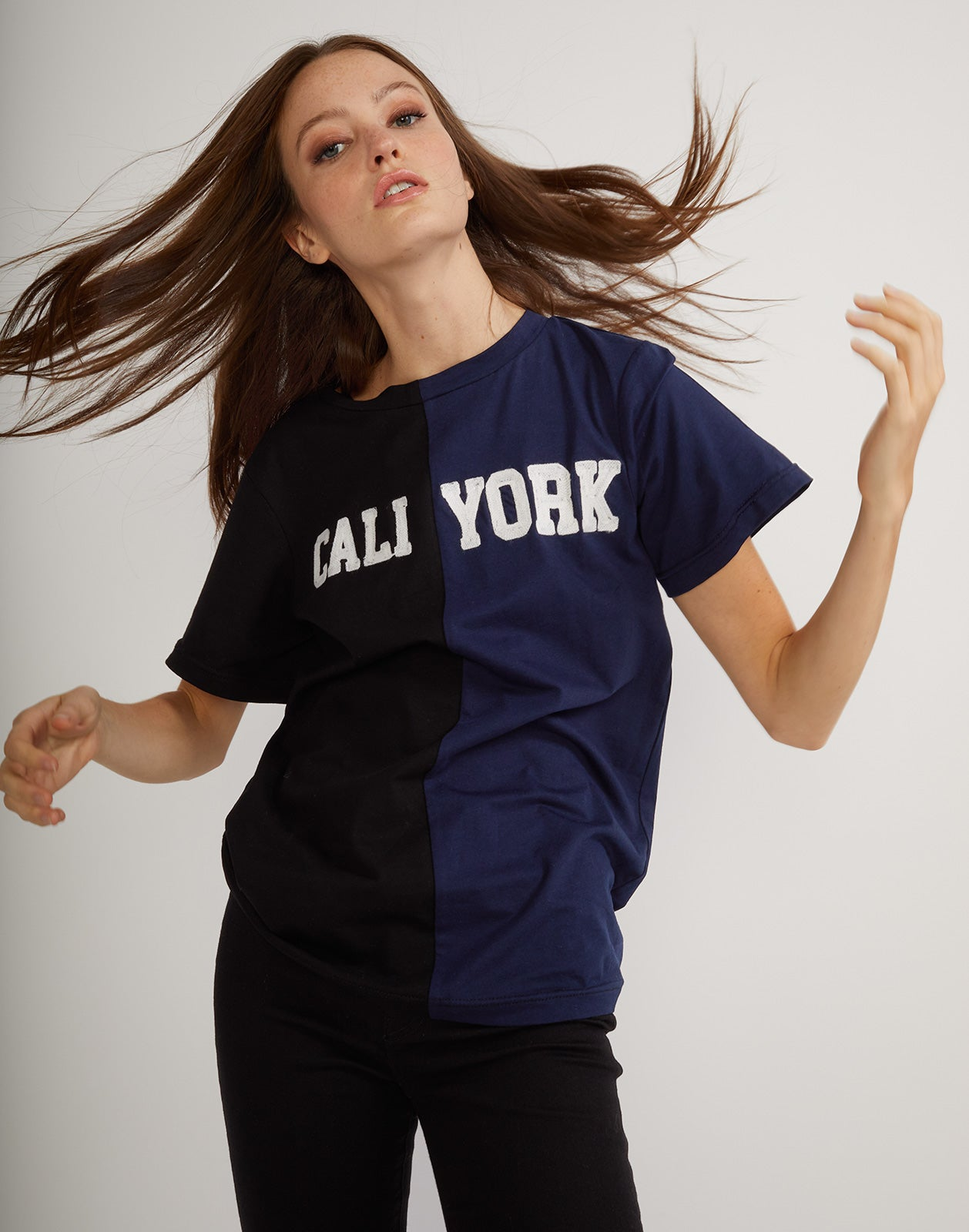 Front side detail of the short sleeved half black, half navy caliyork tee in soft cotton.