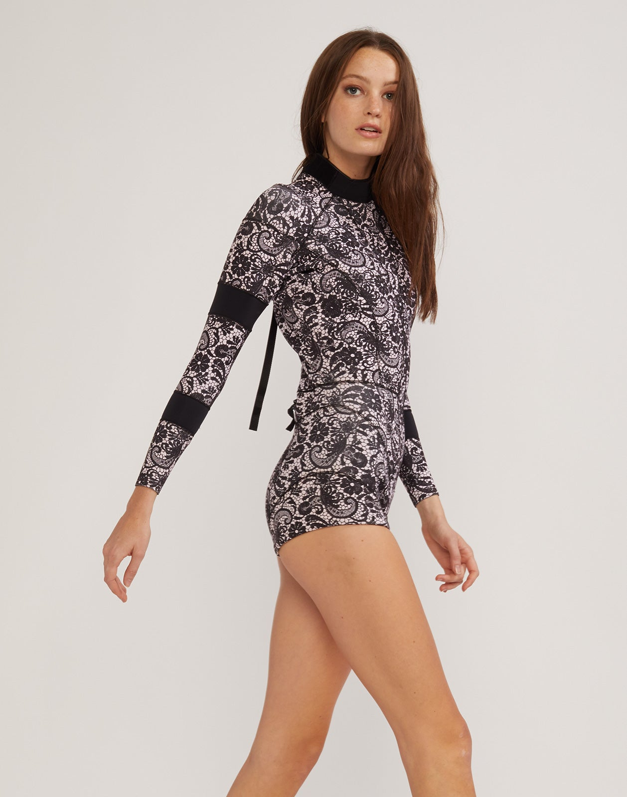 Right side view of the 2mm Fiber-Lite Neoprene wetsuit in black lace print with bonded seams.