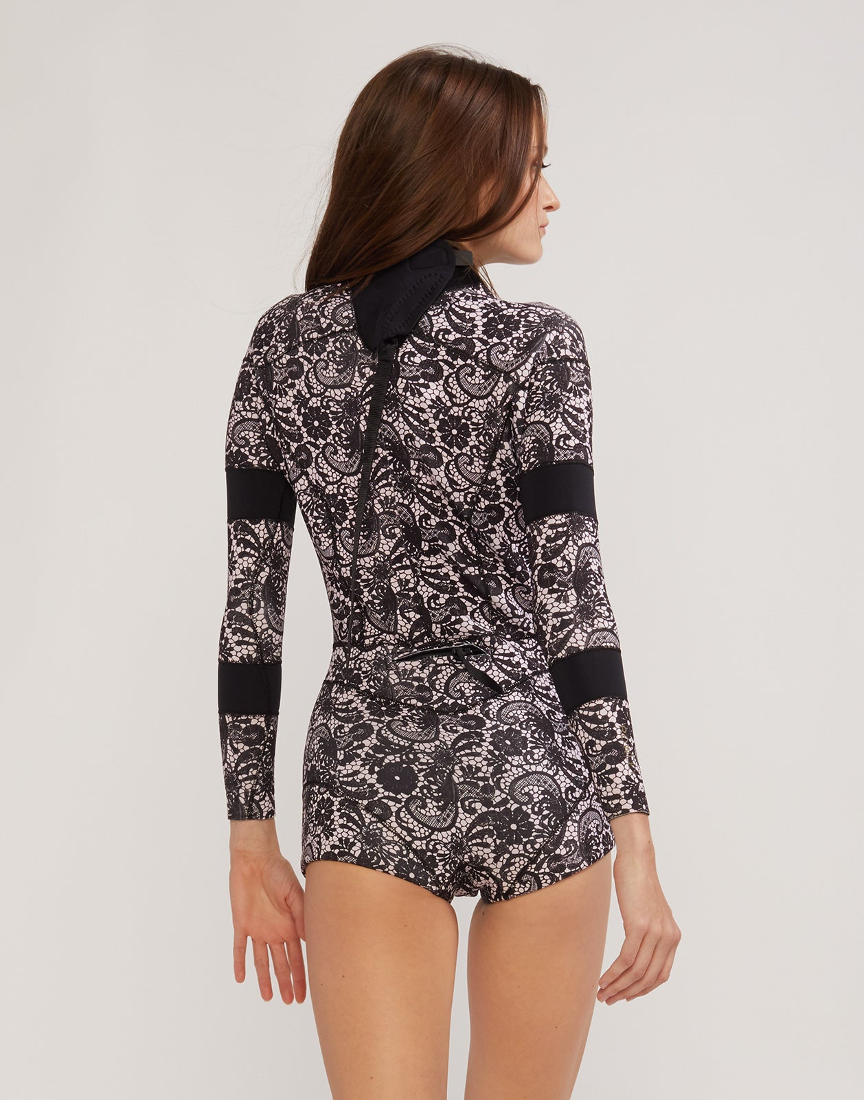 Back view of the 2mm Fiber-Lite Neoprene wetsuit in black lace print with bonded seams.