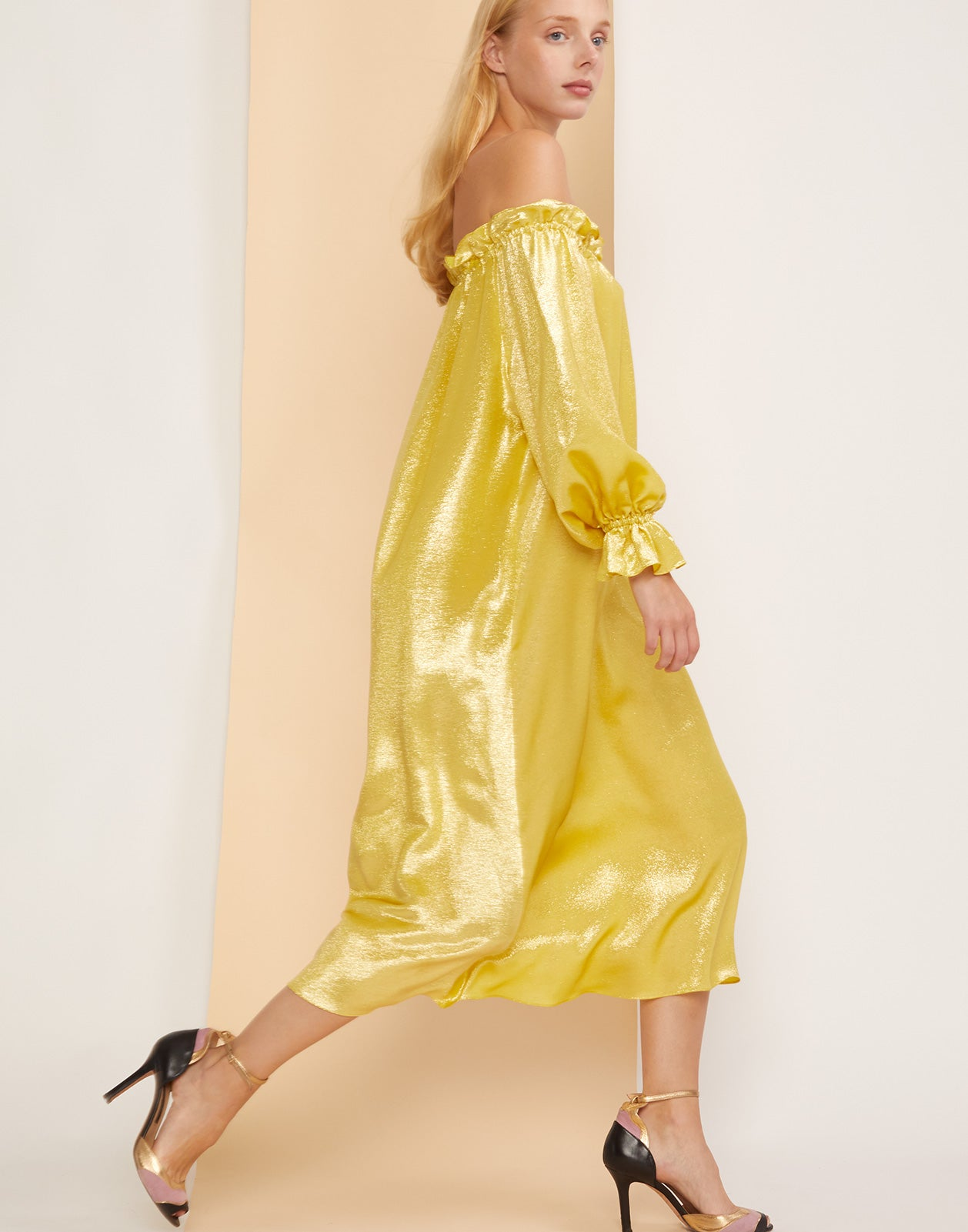Side view of the Shanley yellow shimmer dress.