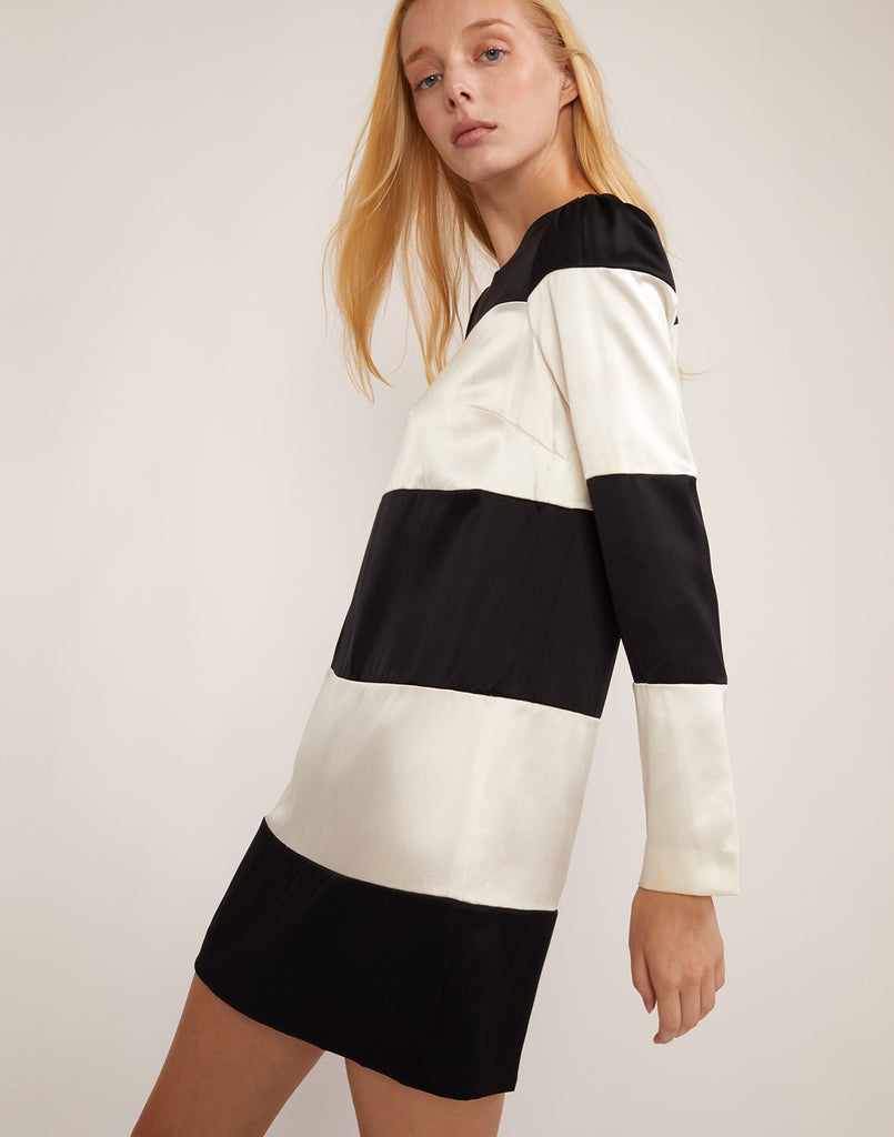 Close side view of Brooklyn black and white striped shift dress.