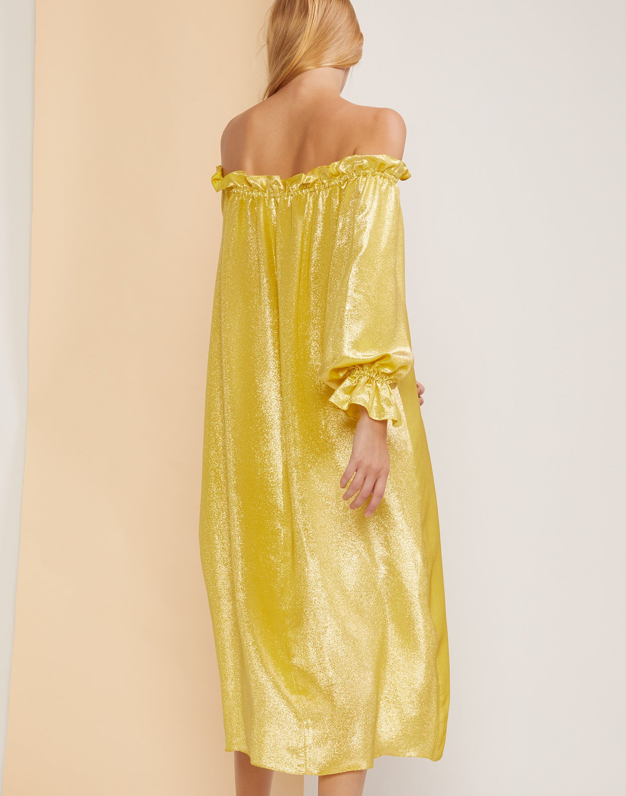 Back view of the yellow metallic shimmer dress.