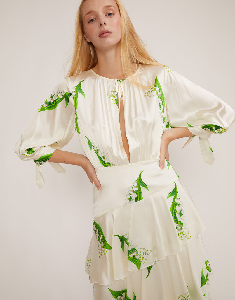 Detail view of Lily of the Valley tiered ruffle dress with front slit opening.