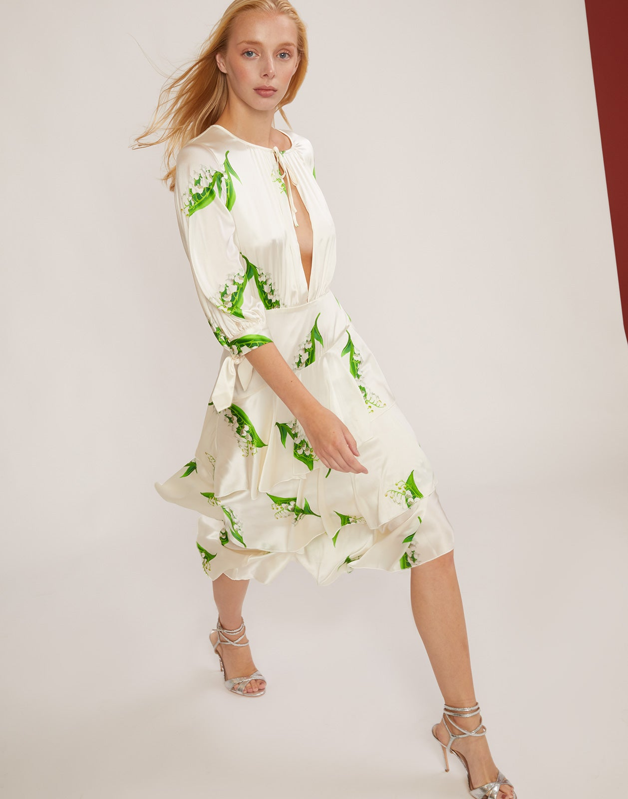 Model walking in the Florence Lily of the Valley print dress.