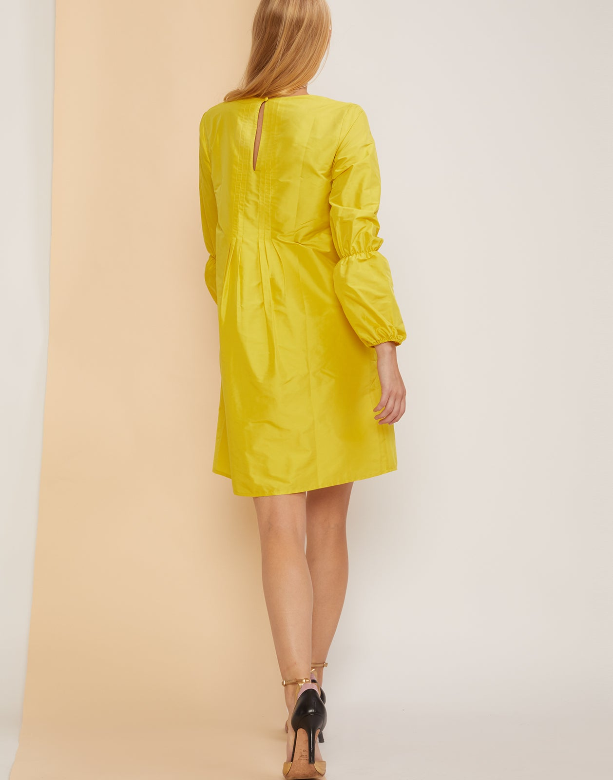 Back view of the Havana Pintuck Dress in Limoncello.