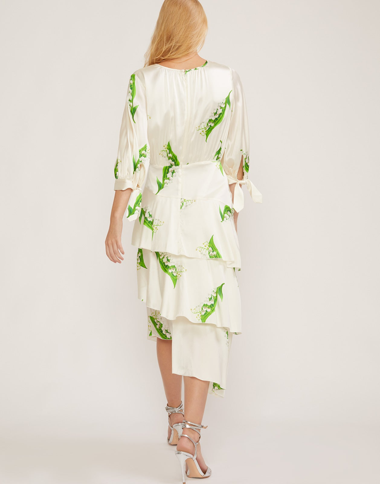 Back view Lily of the Valley tiered ruffle dress with asymmetrical hem.