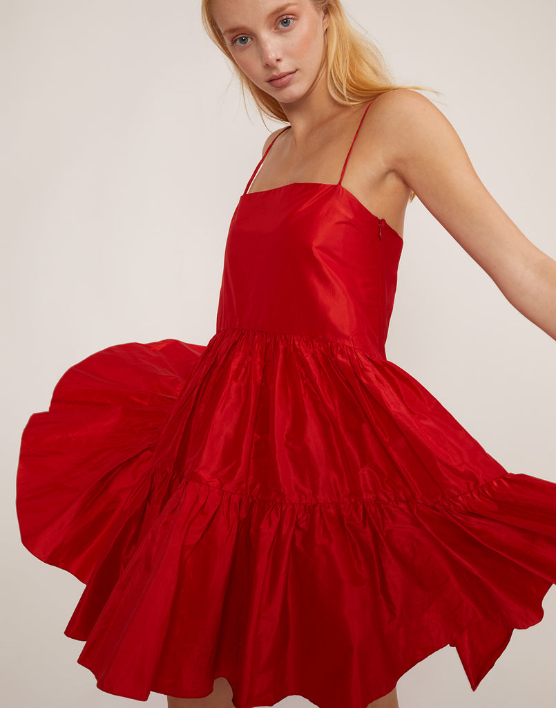 8478202b504 Close view of tiered swing dress in bright cherry red.