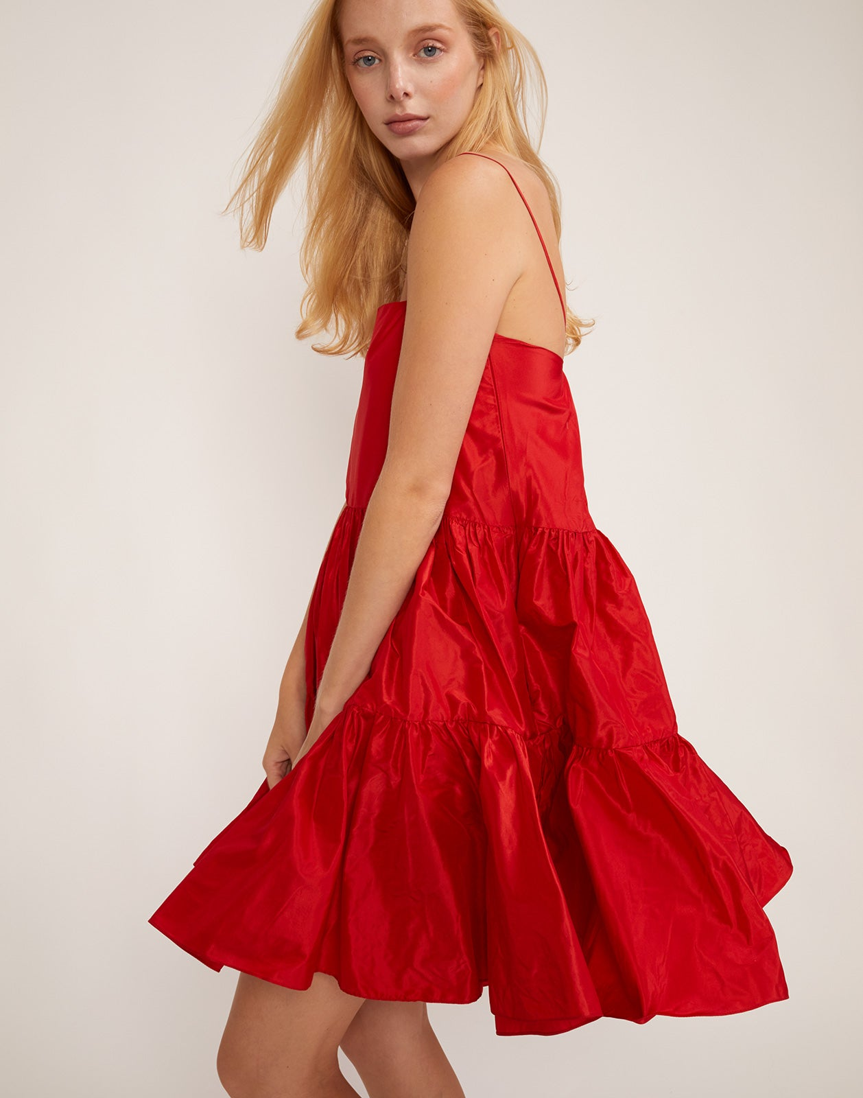 Side view of the Cherry taffeta tiered party dress.