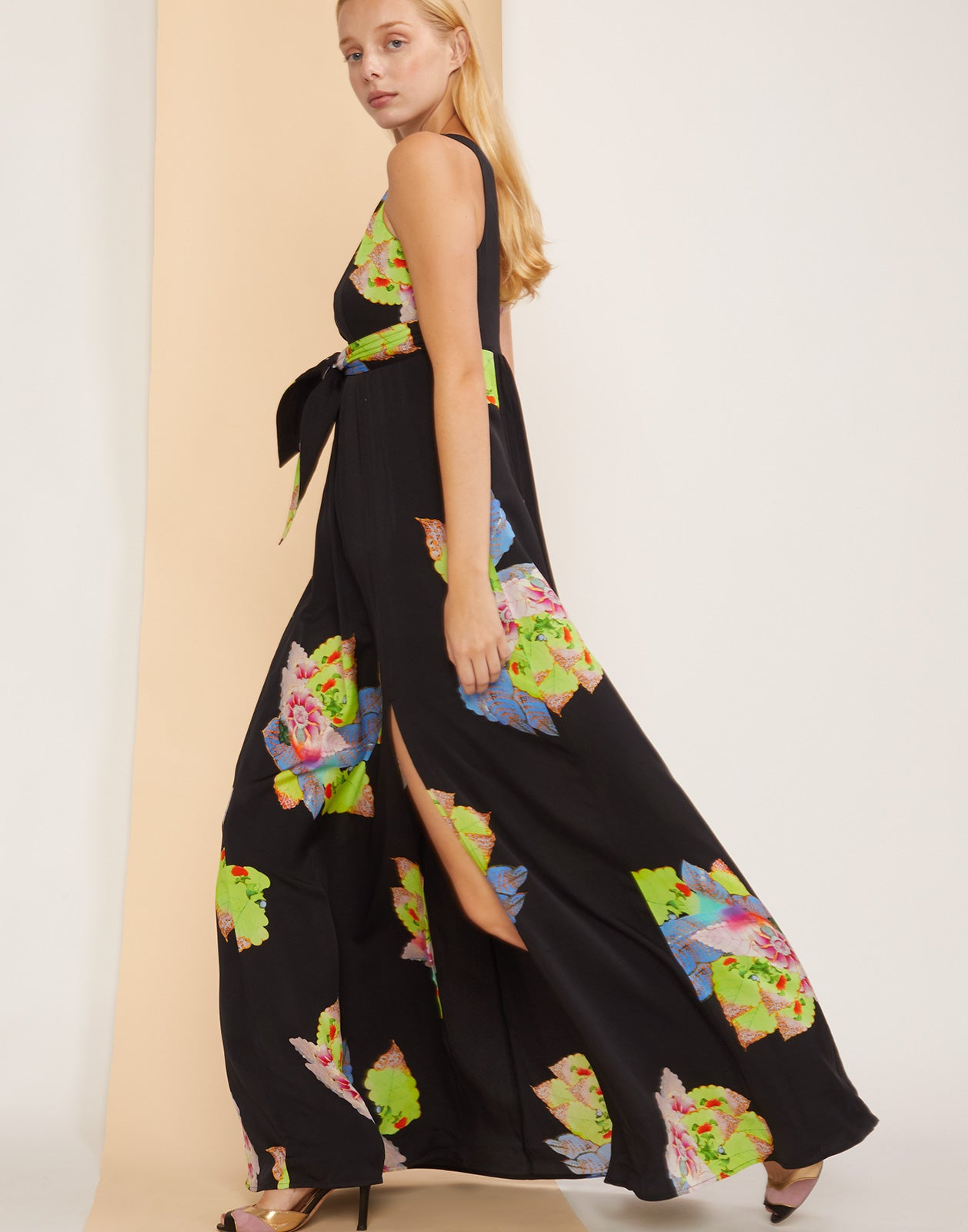 Model side stepping forward in Aurora Maxi Dress with skirt flowing.