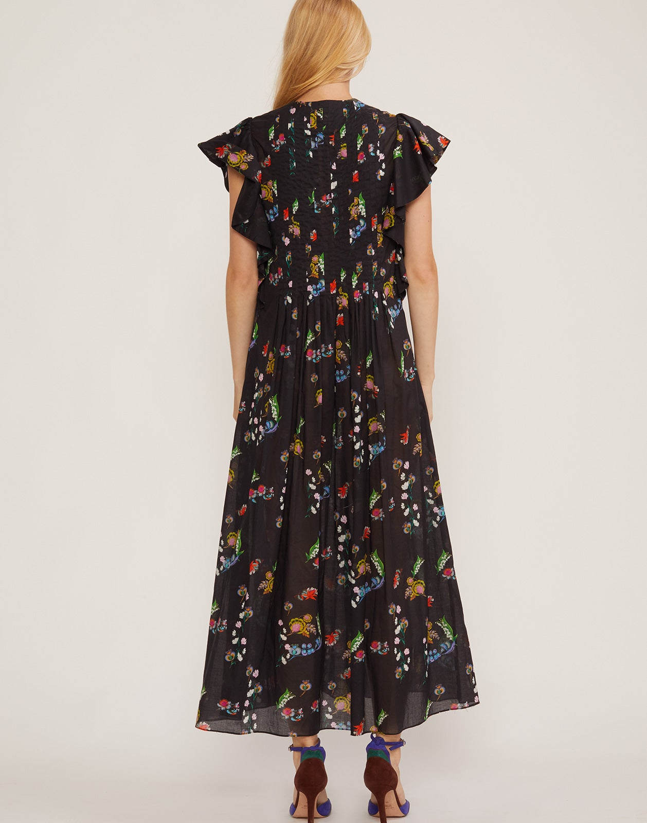 Back view of lightweight cotton maxi dress in garden floral print.