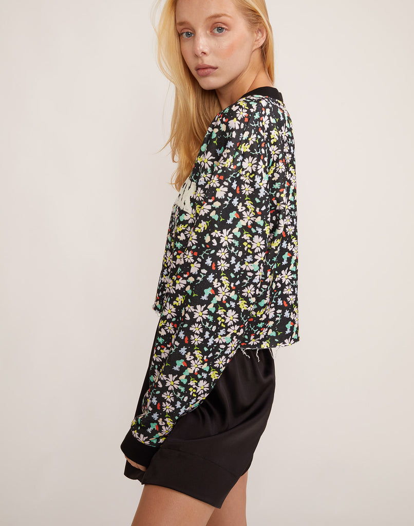 Side view of the CRxBandier cropped floral CaliYork sweatshirt.