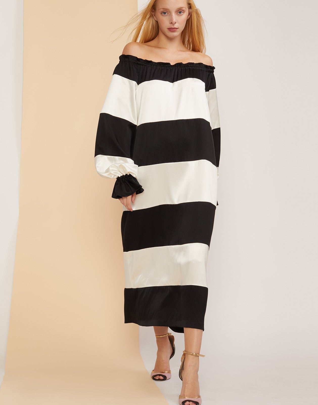 Full front view of the Shanley off shoulder black and white striped dress.