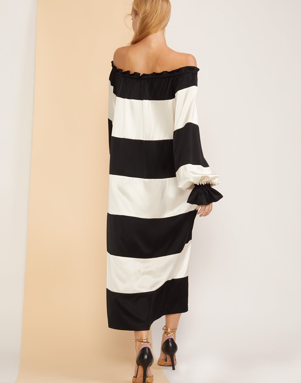 Back view of the Shanley off shoulder black and white striped dress.