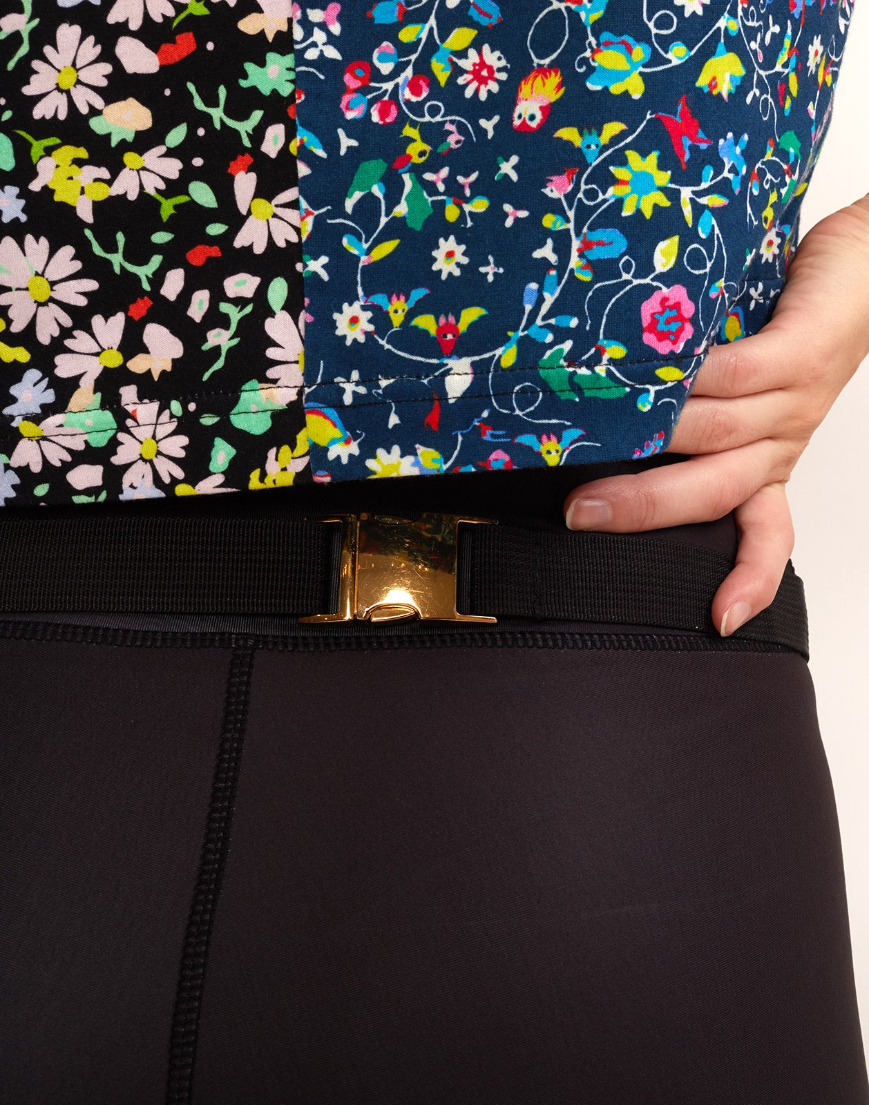 Close view of buckle detail from CRxBandier floral fanny pack.