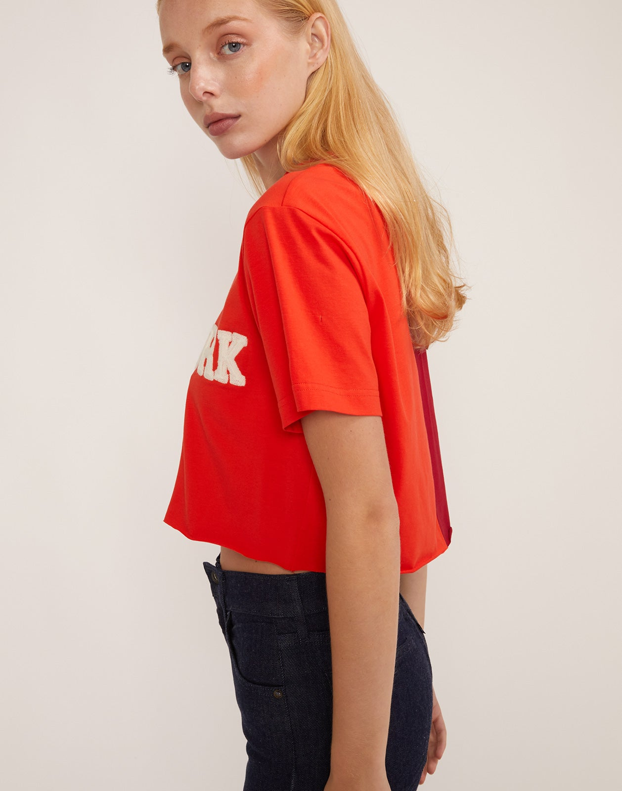 Side view of the CaliYork cropped tee in soft cotton.