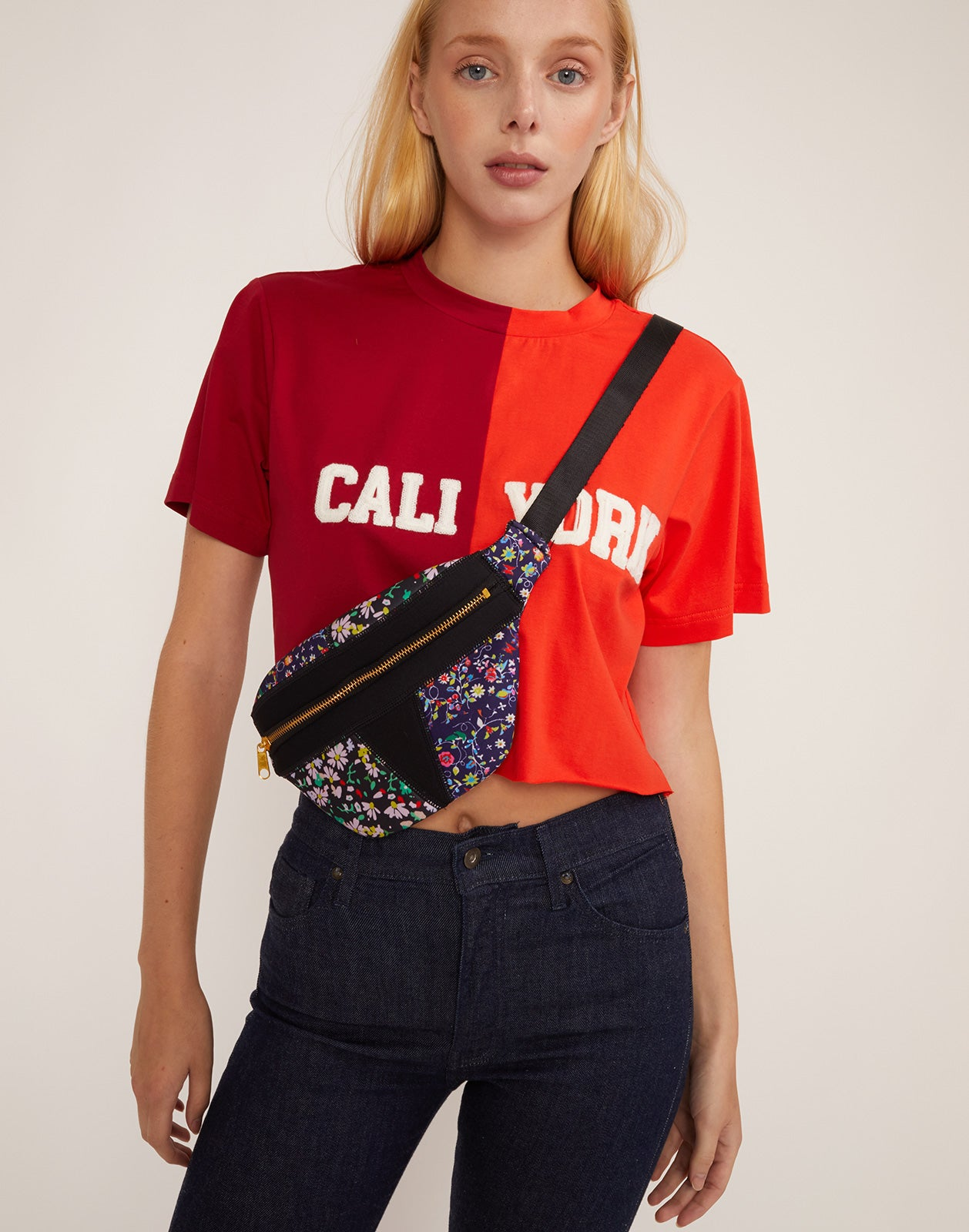Model wearing the mini floral fanny pack as a cross body bag.