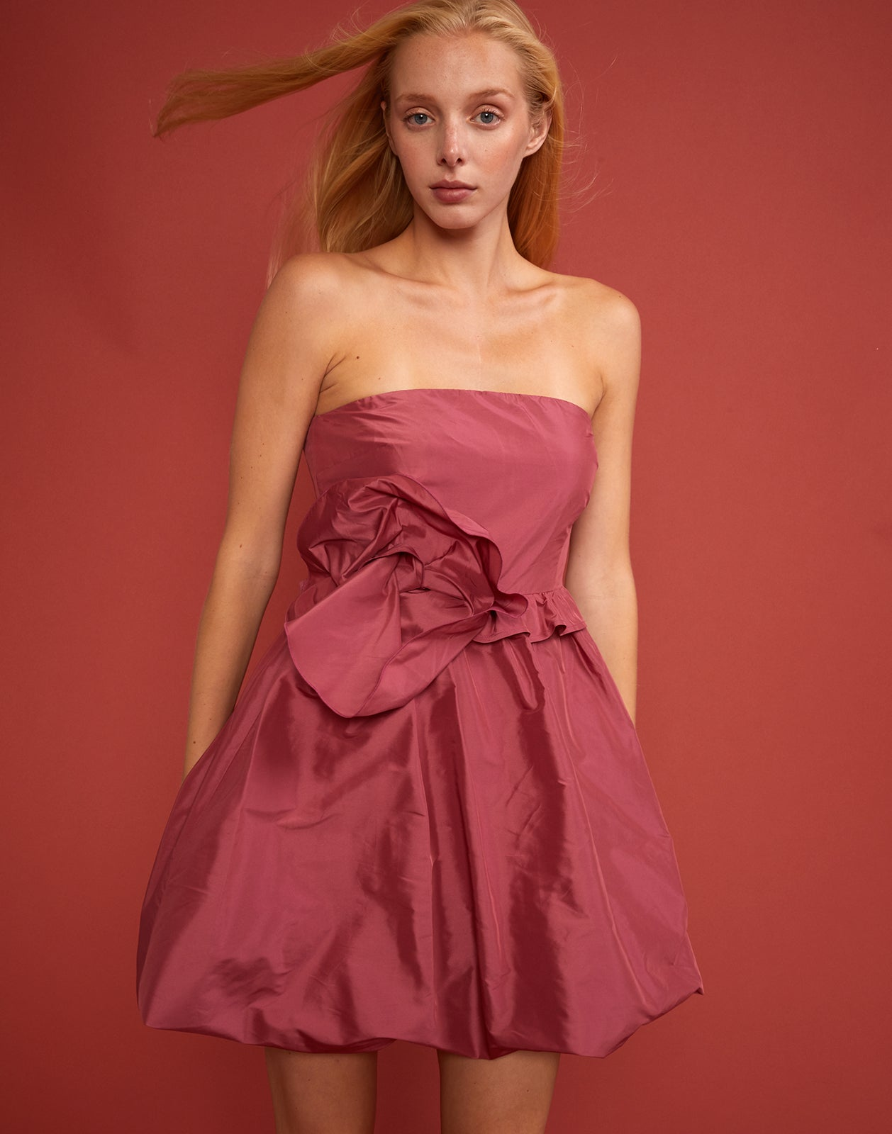 Cropped front view of Lulu Dress with oversized bow detail at waist
