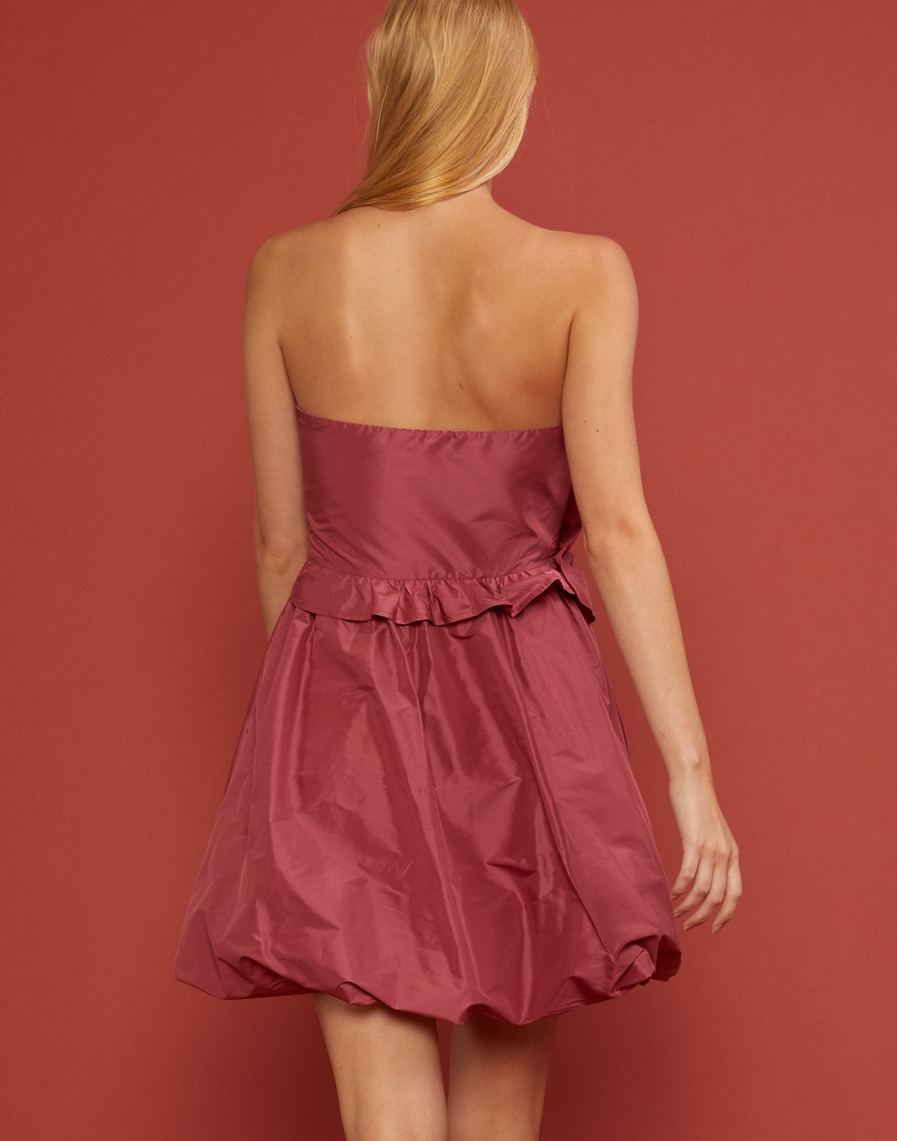Back view of Lulu Dress with oversized bow detail at waist