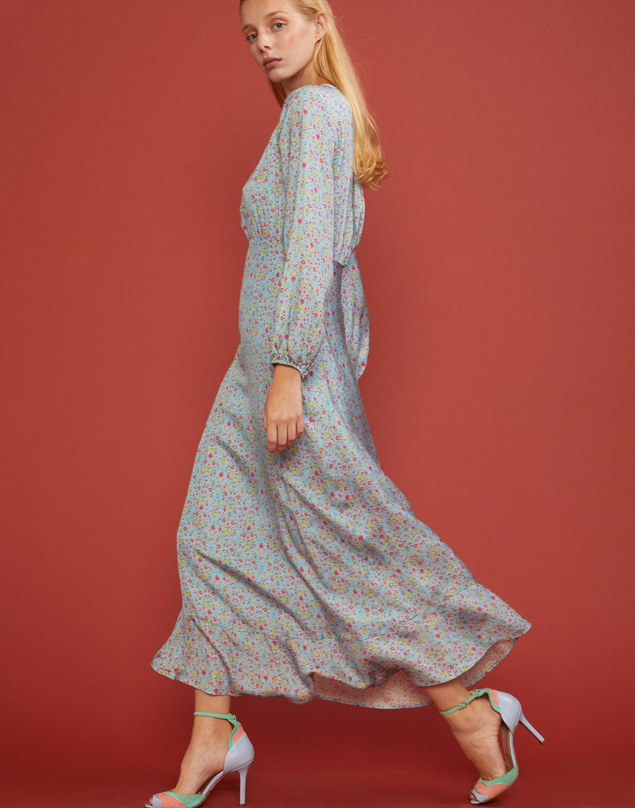 Side view of sky floral printed silk maxi dress with bell sleeves.