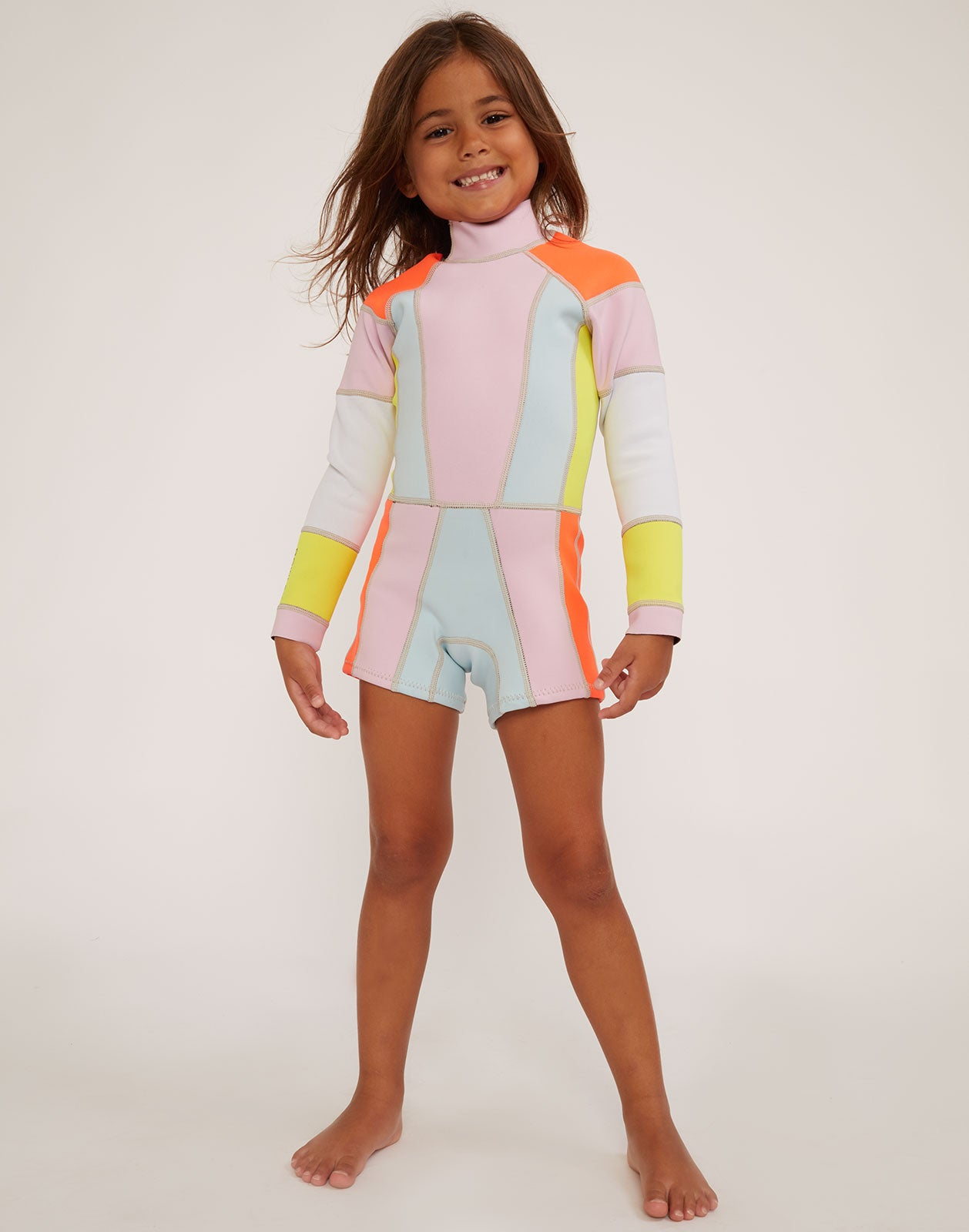 Model wearing the kids colorblock wetsuit.