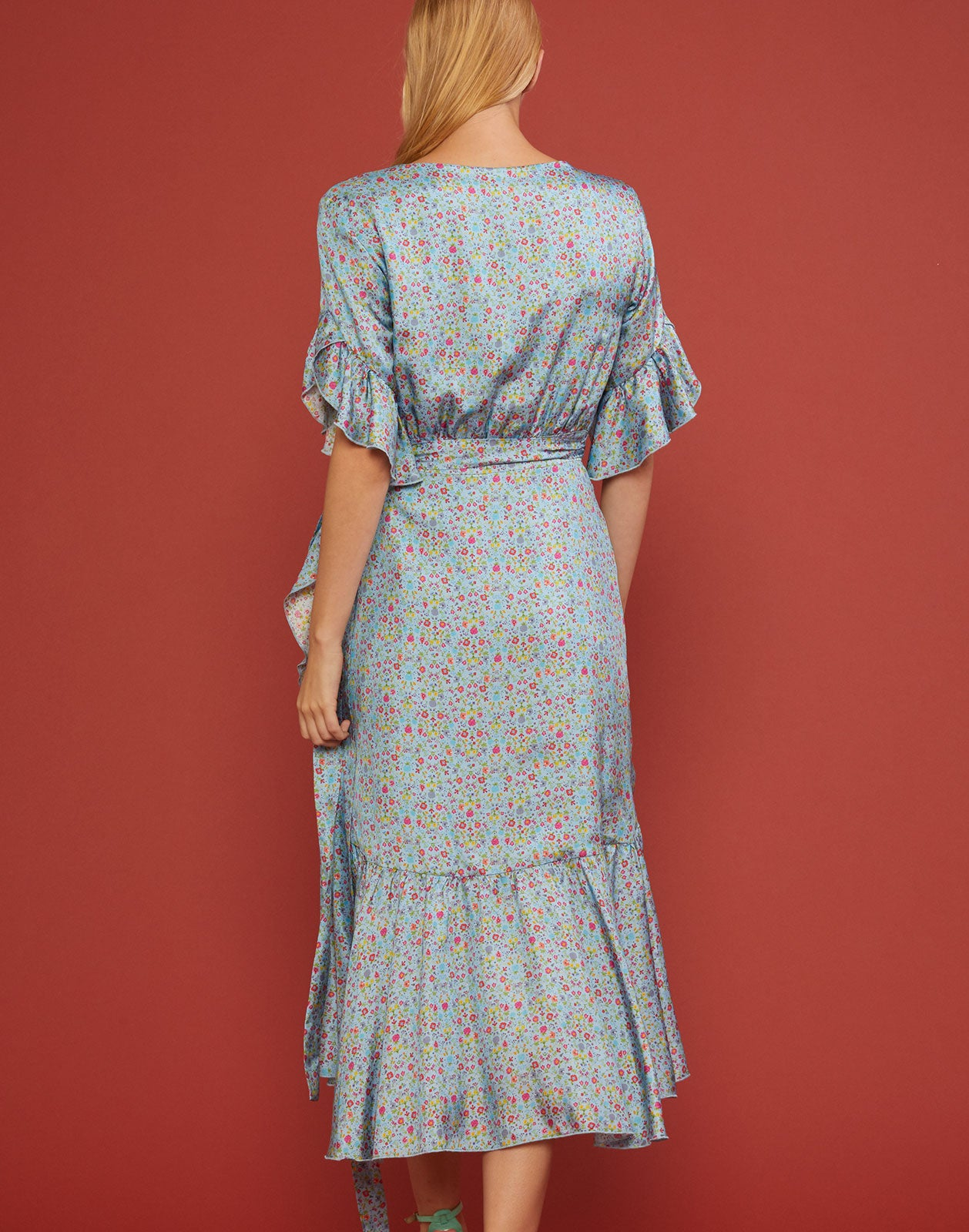 Back view of the Wallflower Sky Floral Wrap Dress in light blue mini floral print.