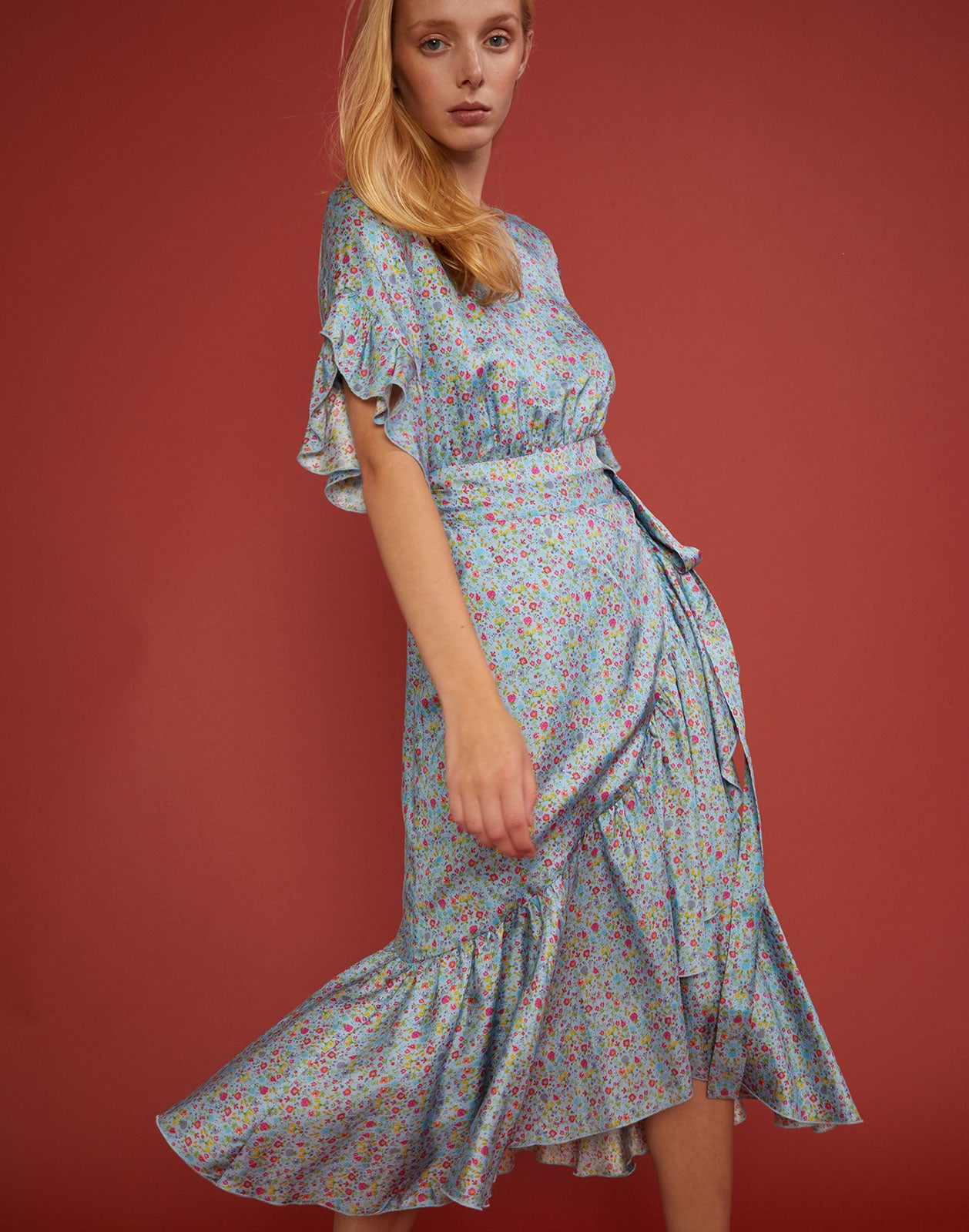 Close view of the silk printed sky floral Wallflower dress in light blue.