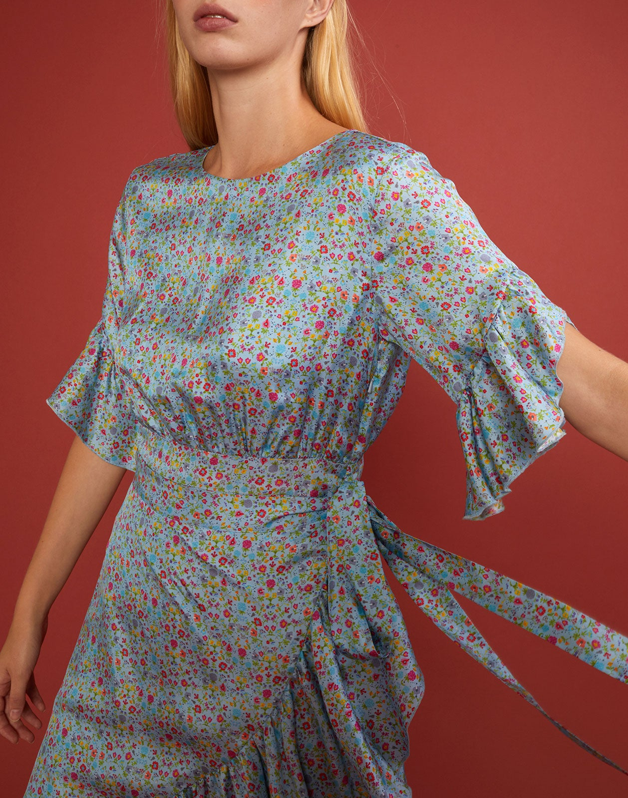 Front detail view of the sky floral wallflower wrap dress.