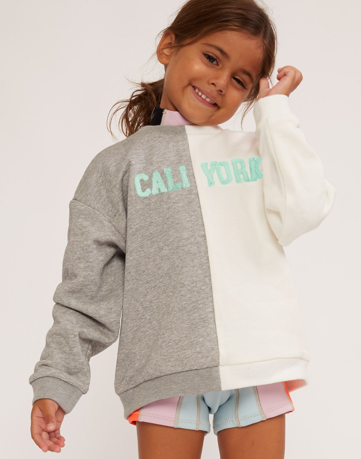 Kid's CaliYork cotton sweatshirt in half grey, half white.