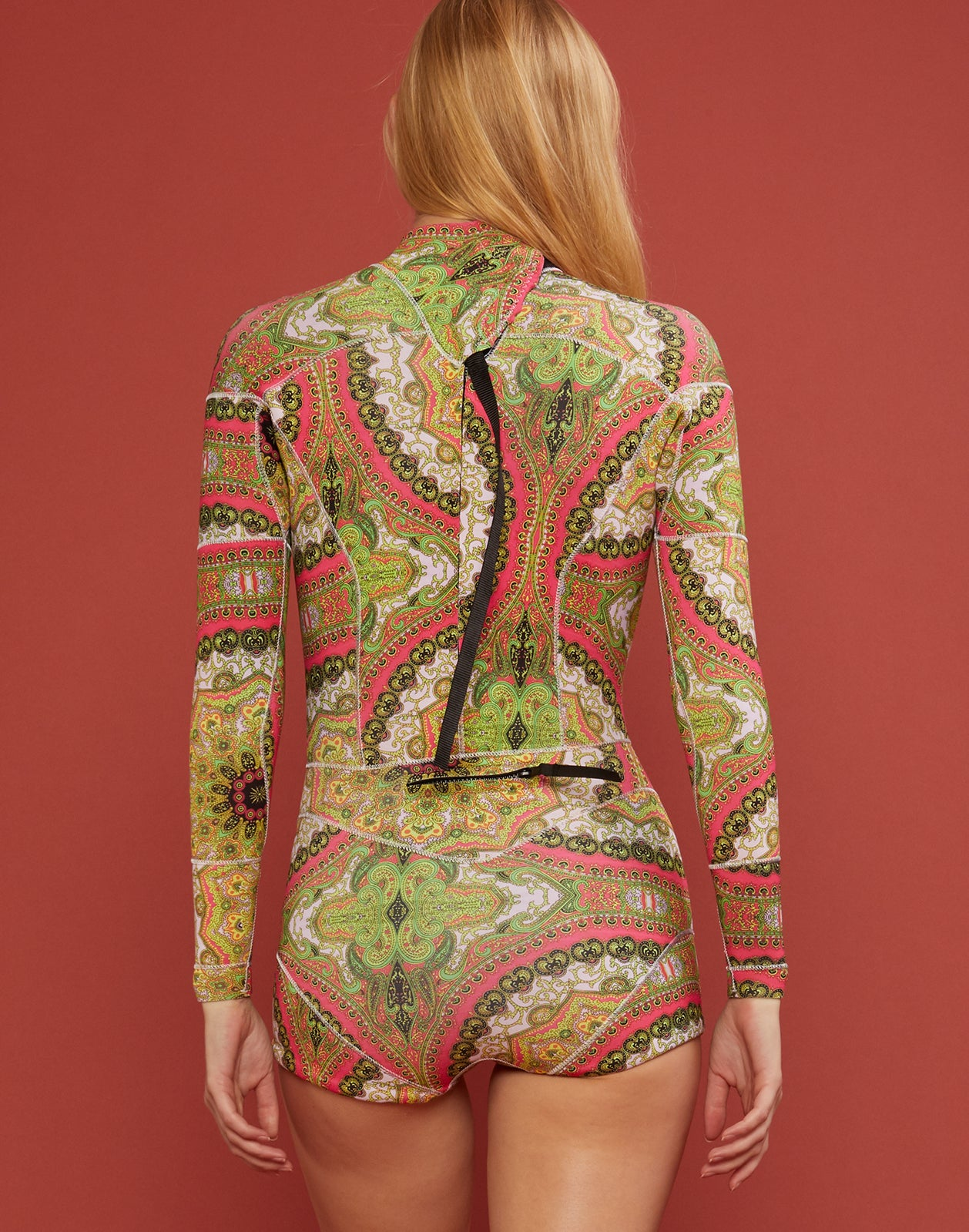 Back view of pink paisley neoprene wetsuit in pink paisley print.