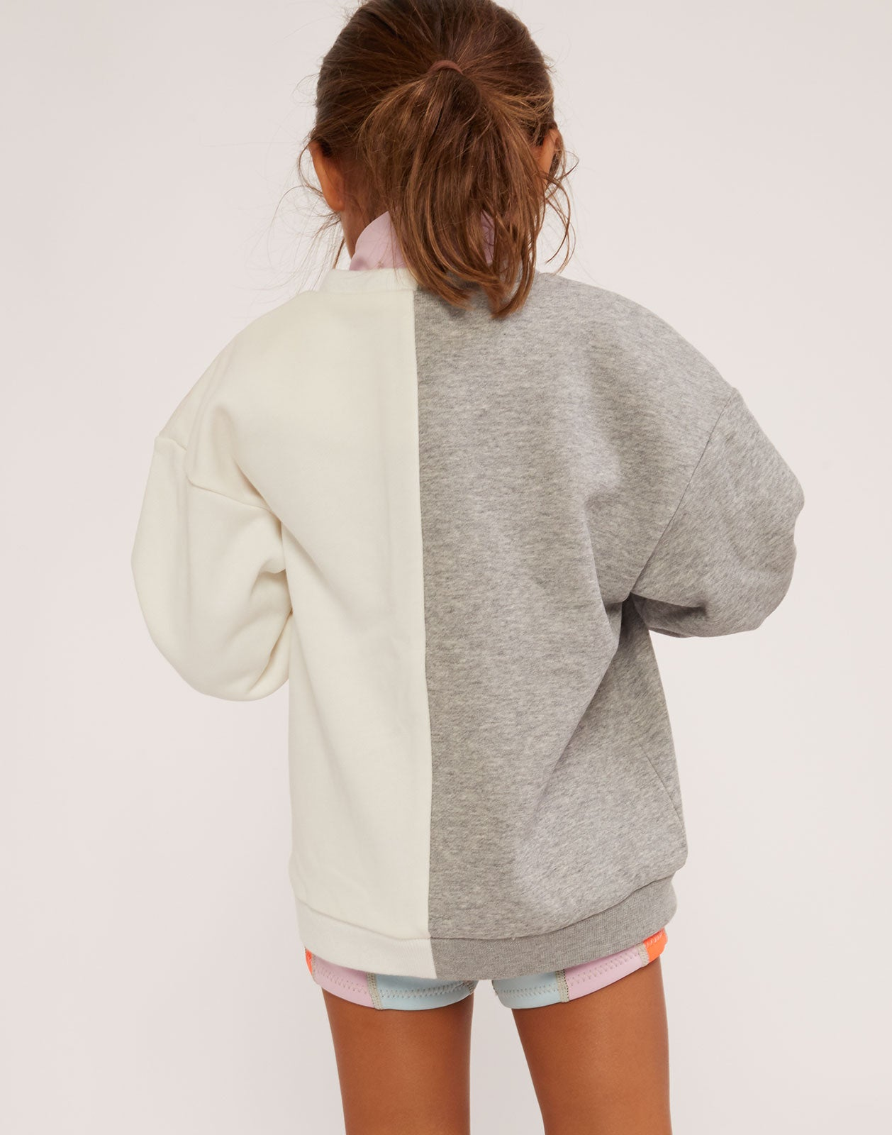 Back view of Kid's CaliYork Sweatshirt in half grey and half white.