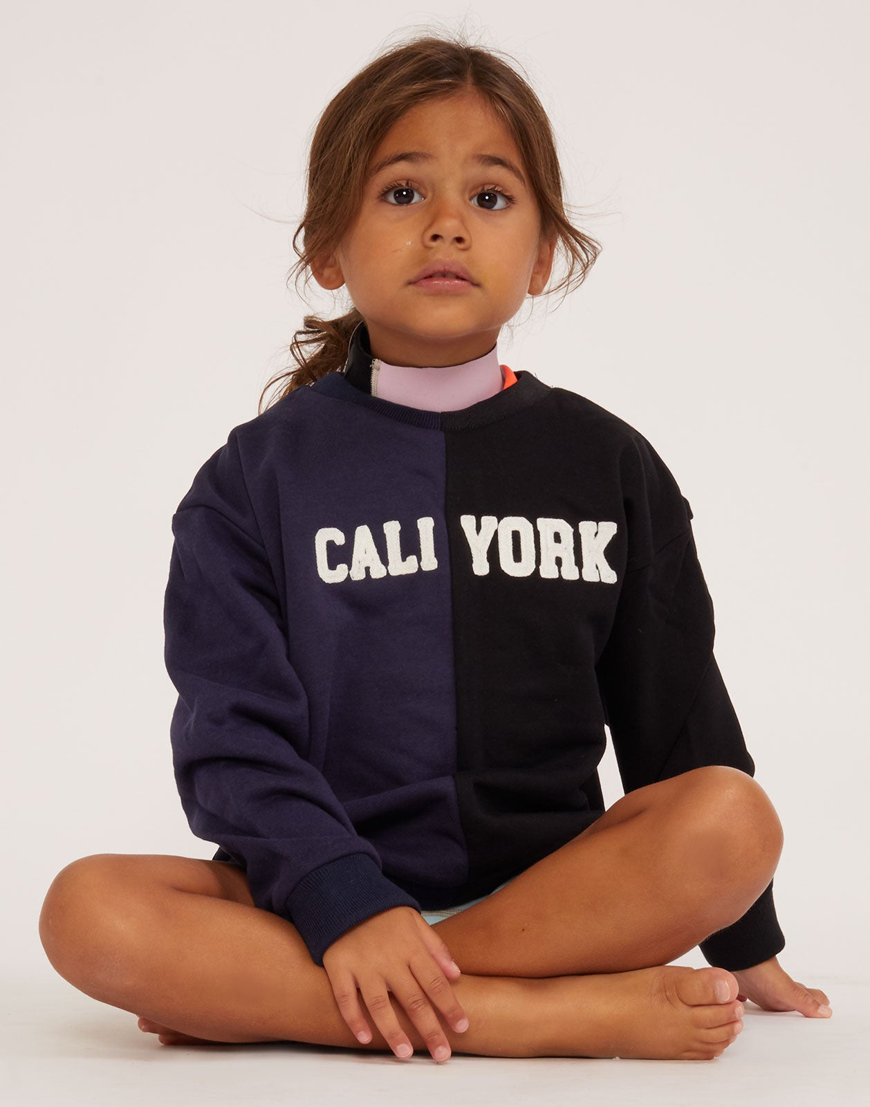 Kid's CaliYork cotton sweatshirt in navy and black.