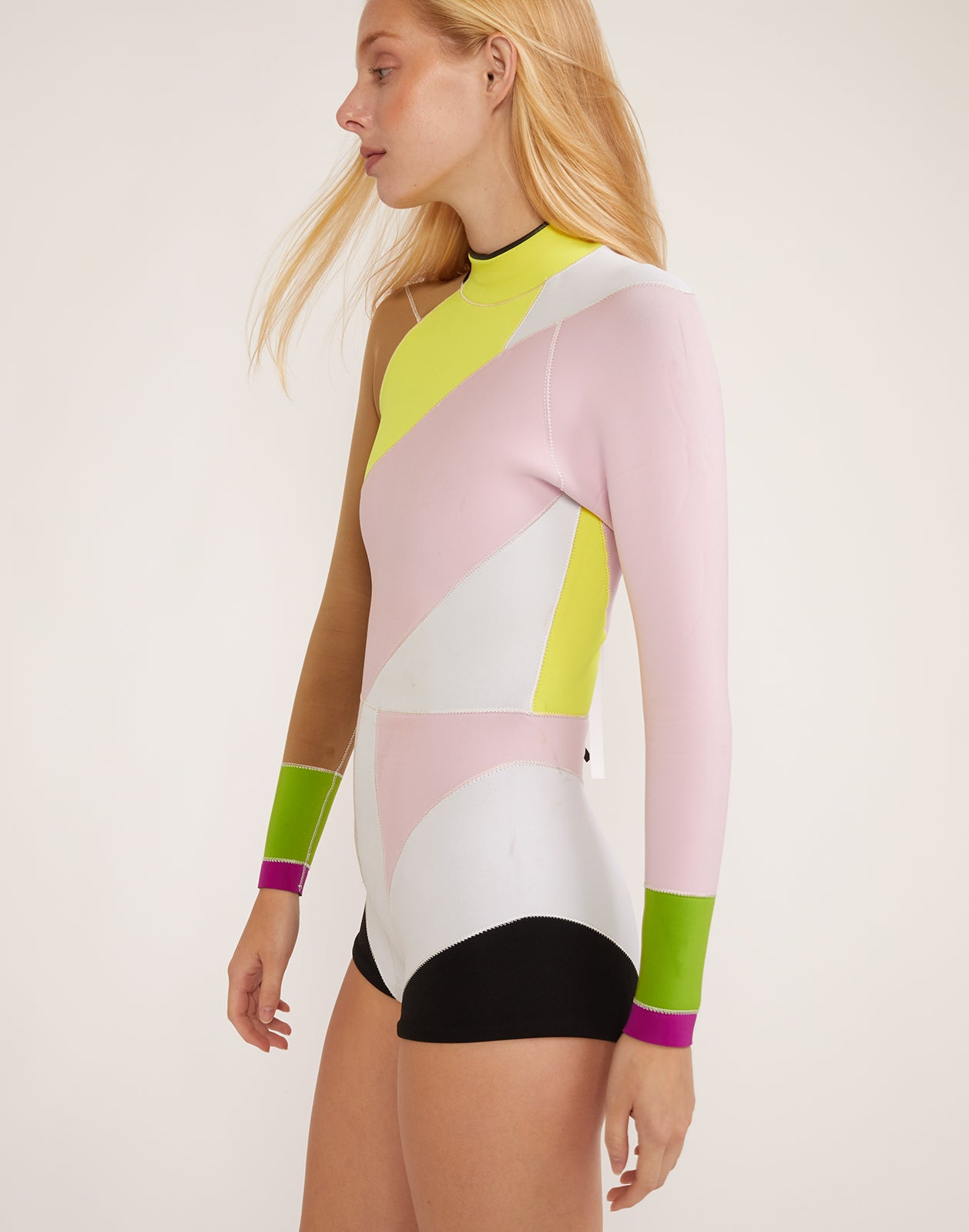 Side view of asymmetrical design Quincy Wetsuit with long sleeves