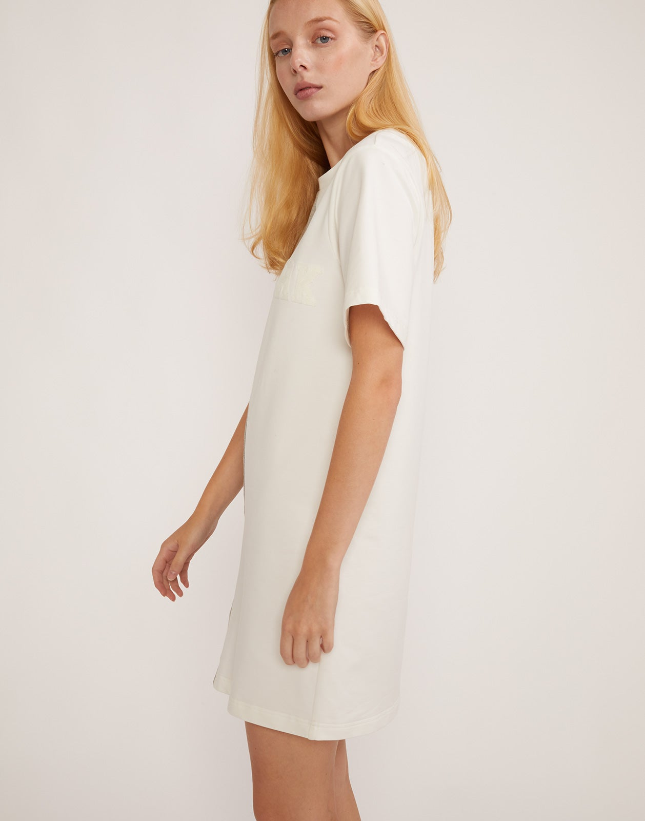 Side view of CaliYork t-shirt dress.