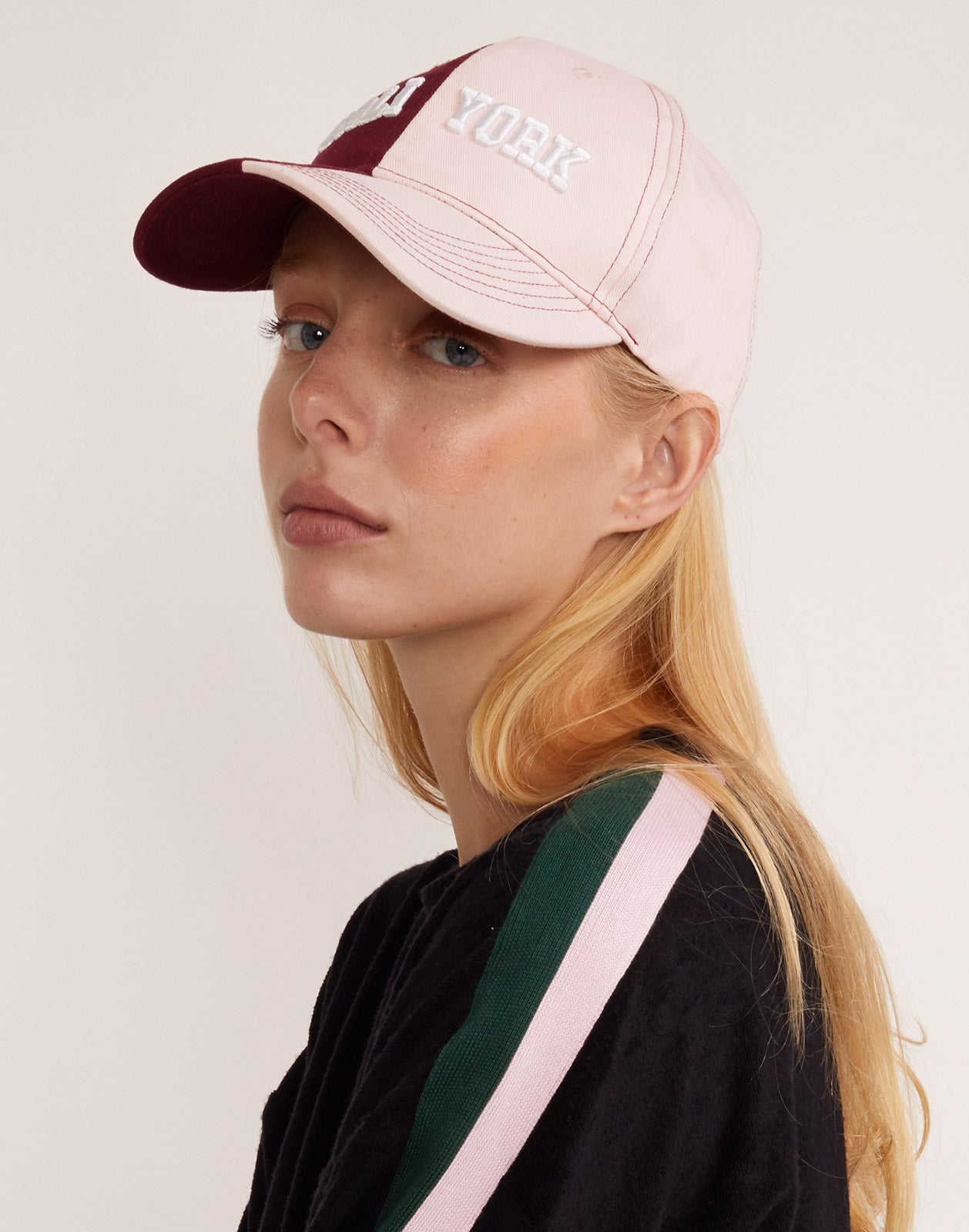 CR x Bandier two tone base ball hat seen from the blush side.