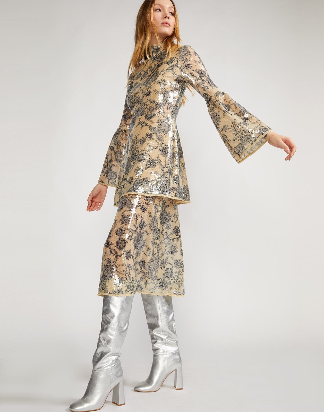 Sequined floral motif dress with long bell sleeves and fitted through waist