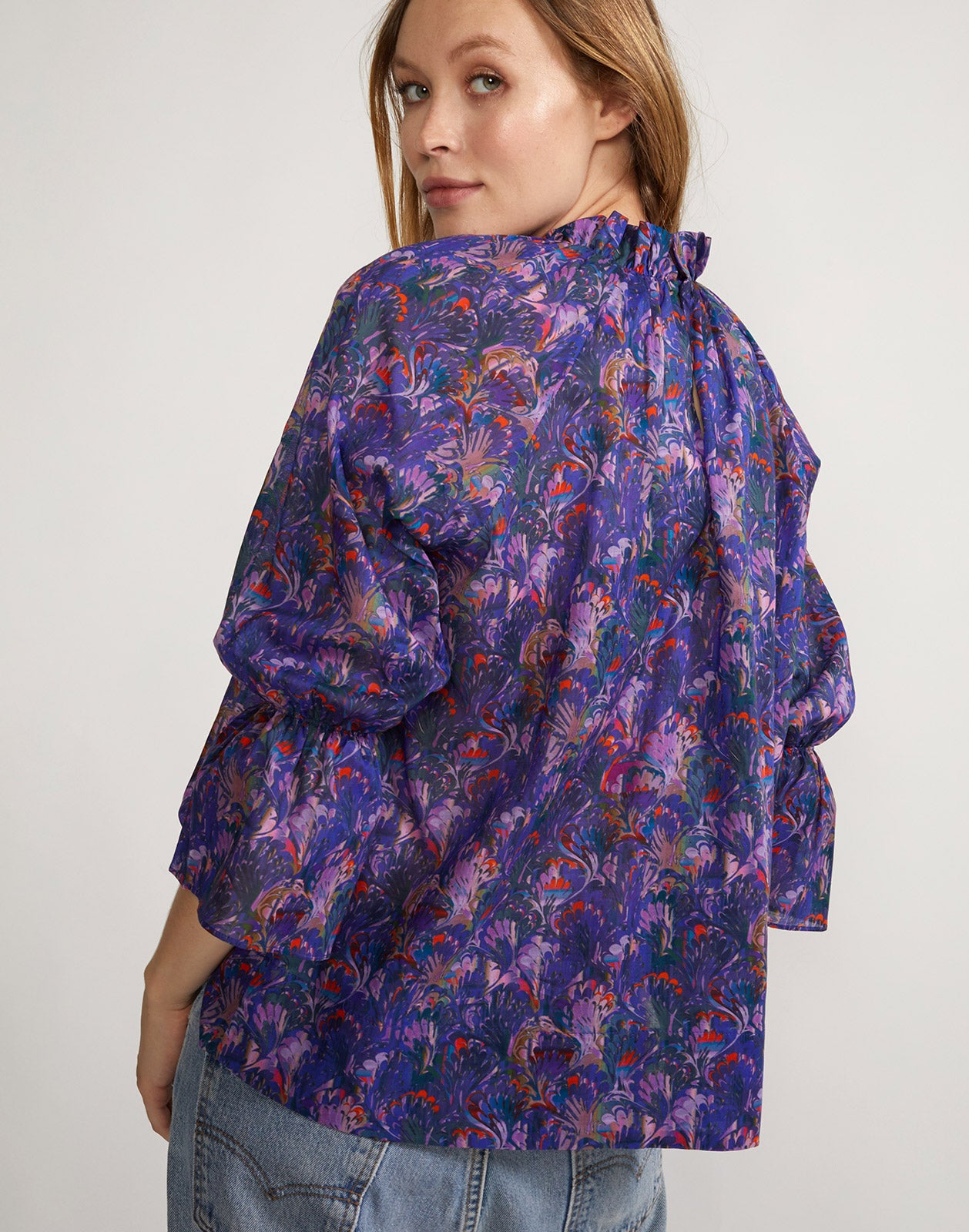 Back view of waterfall blouse with purple marble print