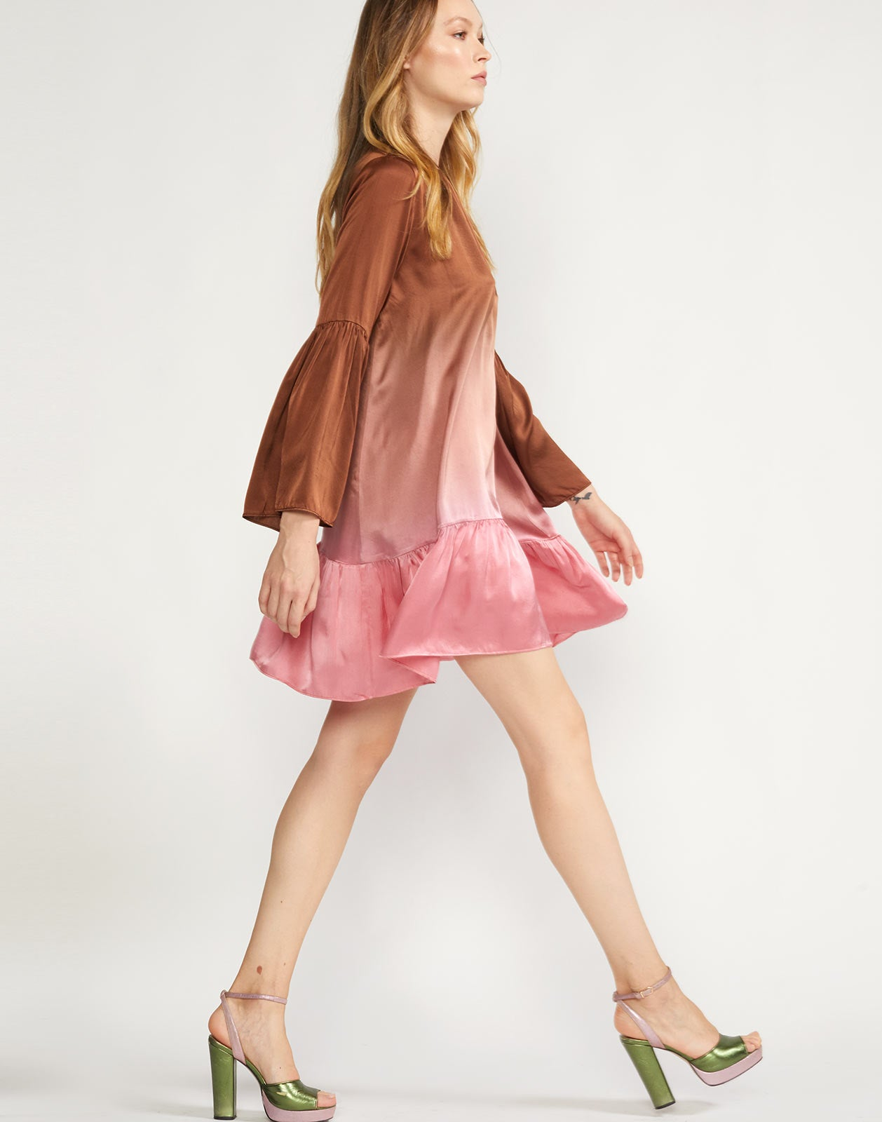 Side view of swing dress with long bell sleeves and keyhole neck closure