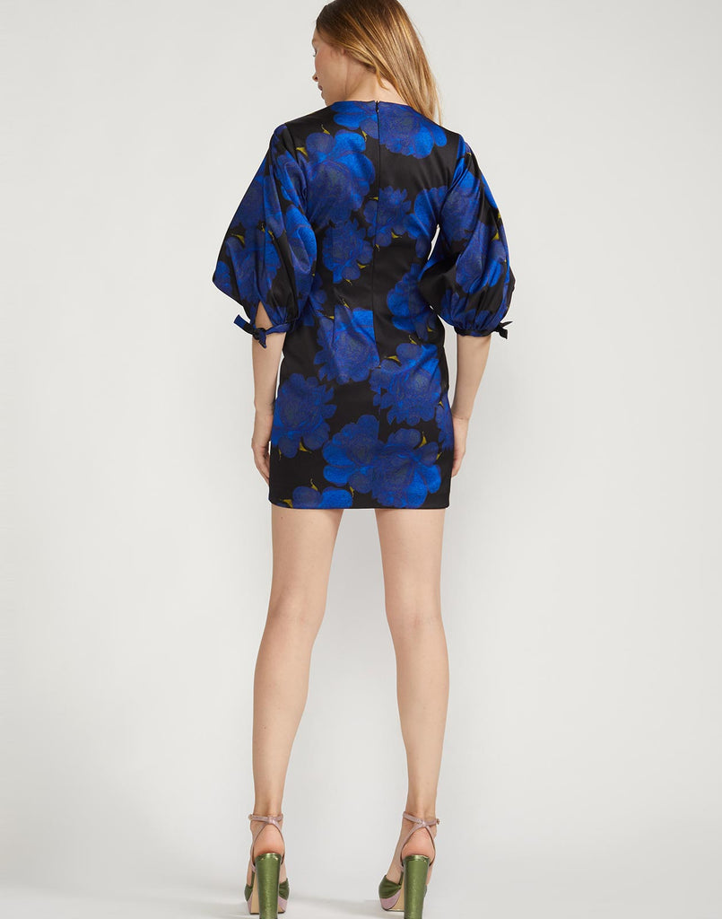 Back view of mini brocade dress with puff sleeves