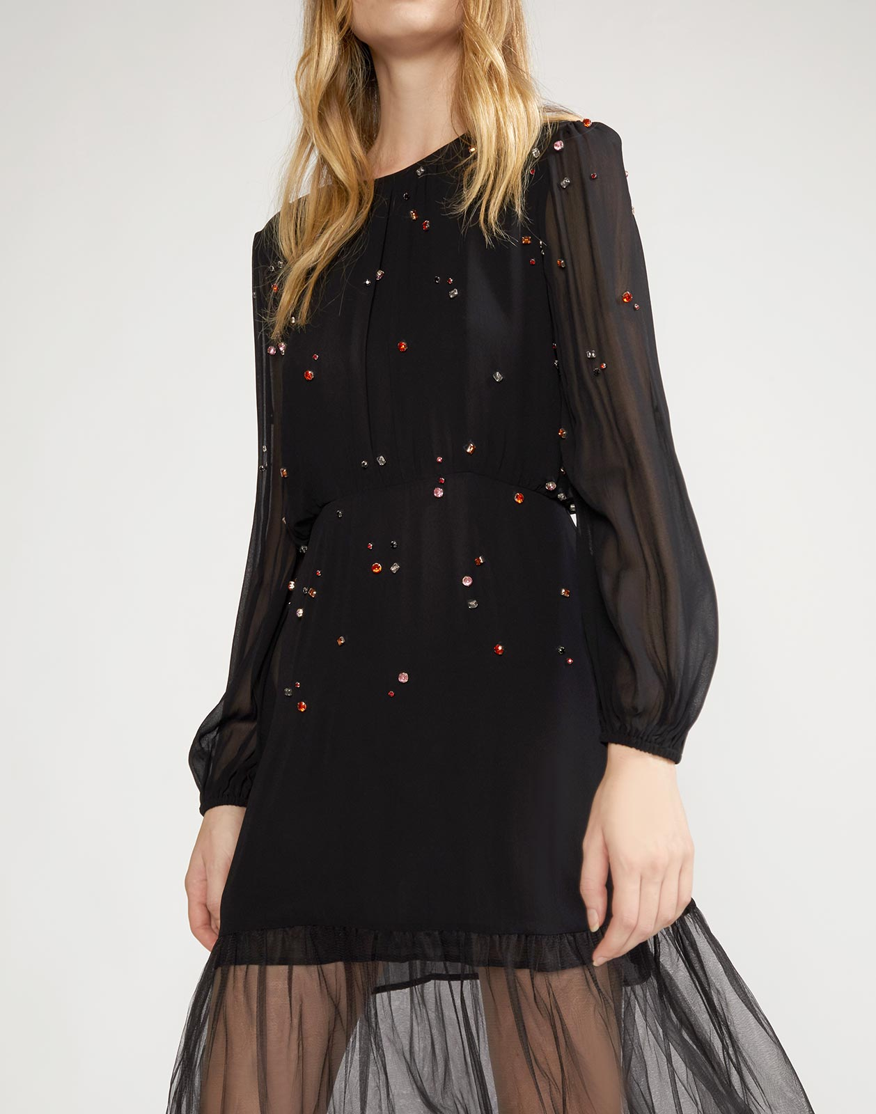 Close view of the Rhinestone embellished dress with sheer chiffon sleeves