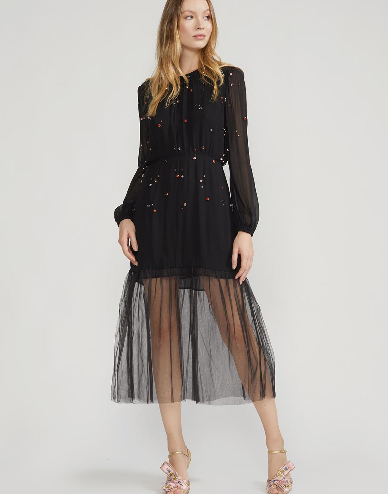 Full view of the Rhinestone embellished dress with sheer accents and tulle skirt