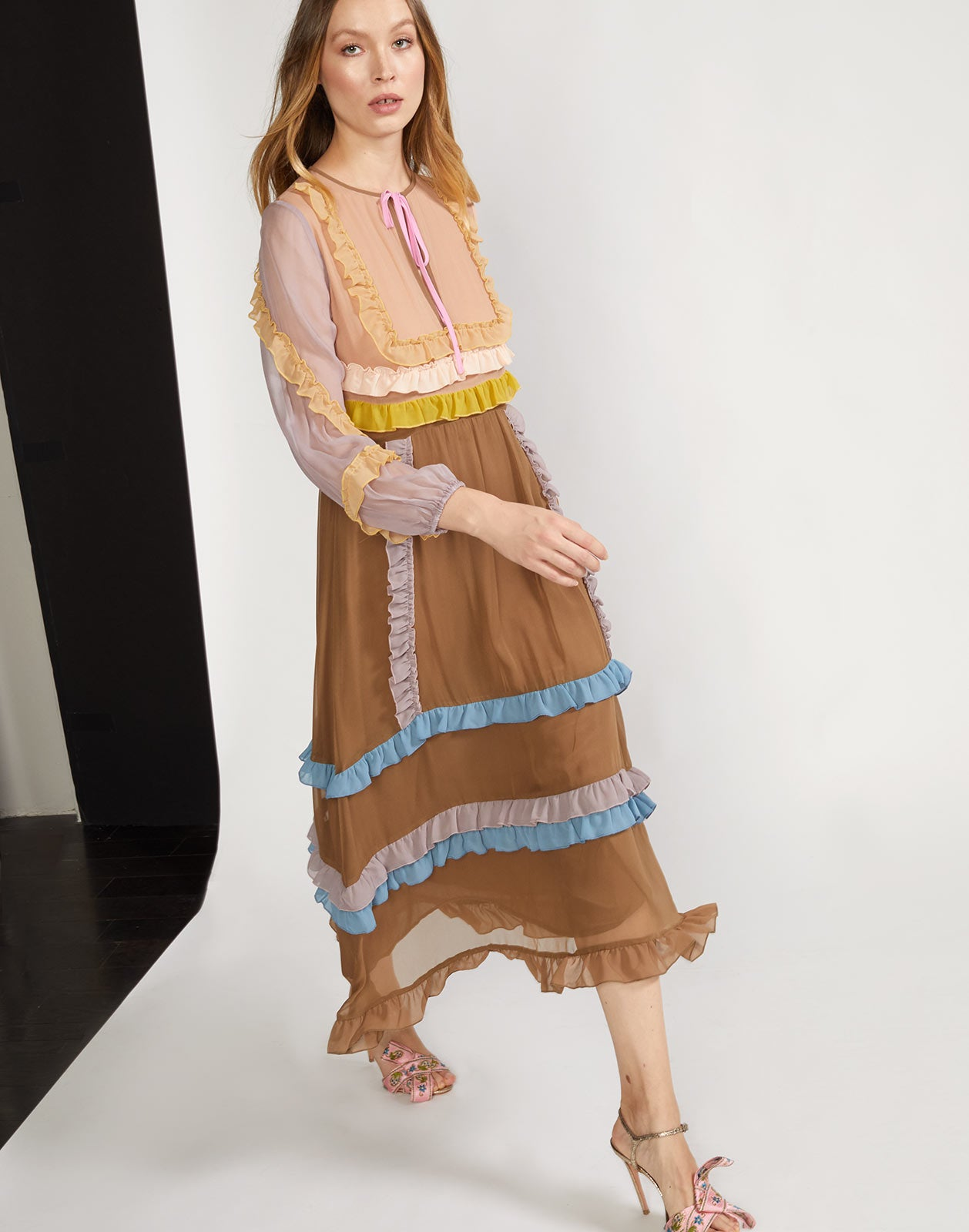 Model walking view of lightweight chiffon maxi dress with mini multi-color ruffles
