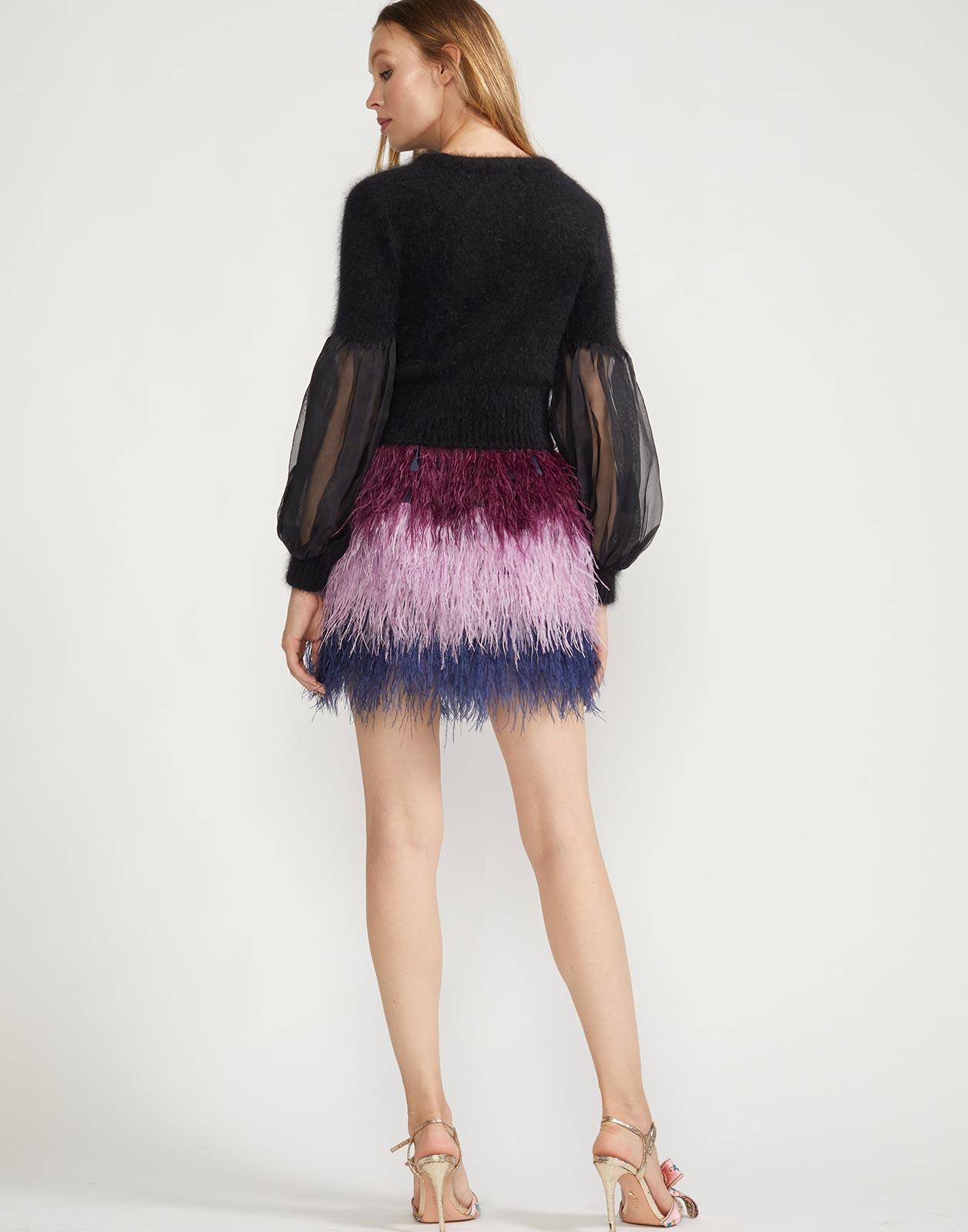 Back view of crew neck sweater with sheer puff sleeves