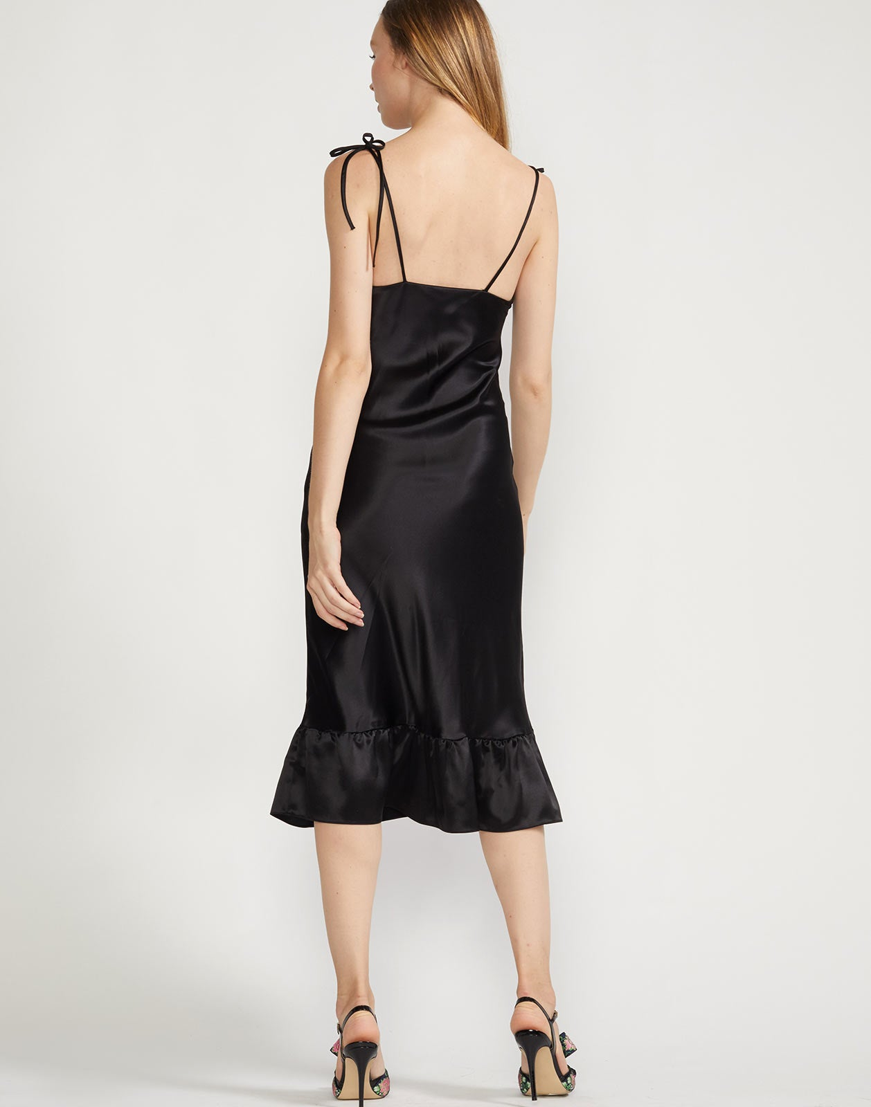 Back view of slip dress with close to body fit