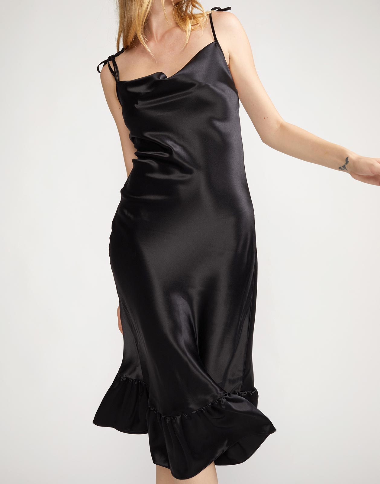 Close up view of silk slip dress with mini flounce hem