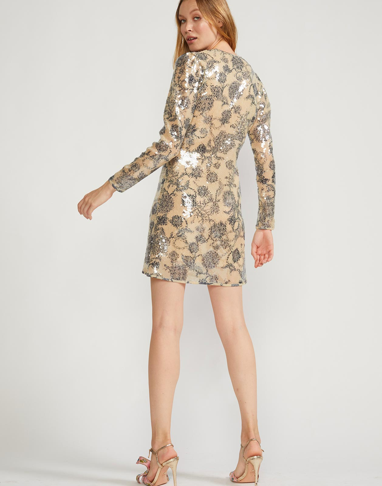 Back view of long sleeved mini dress with sequin embellishment